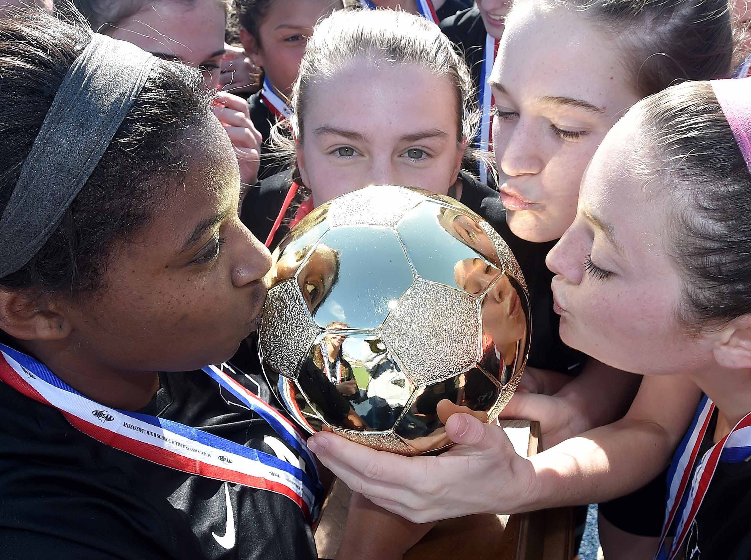 The West Lauderdale Lady Knights kiss the Class 4A state championship trophy after winning the MHSAA BlueCross Blue Shield of Mississippi Soccer Classic on Saturday, February 9, 2019, at Ridgeland High School in Ridgeland, Miss.