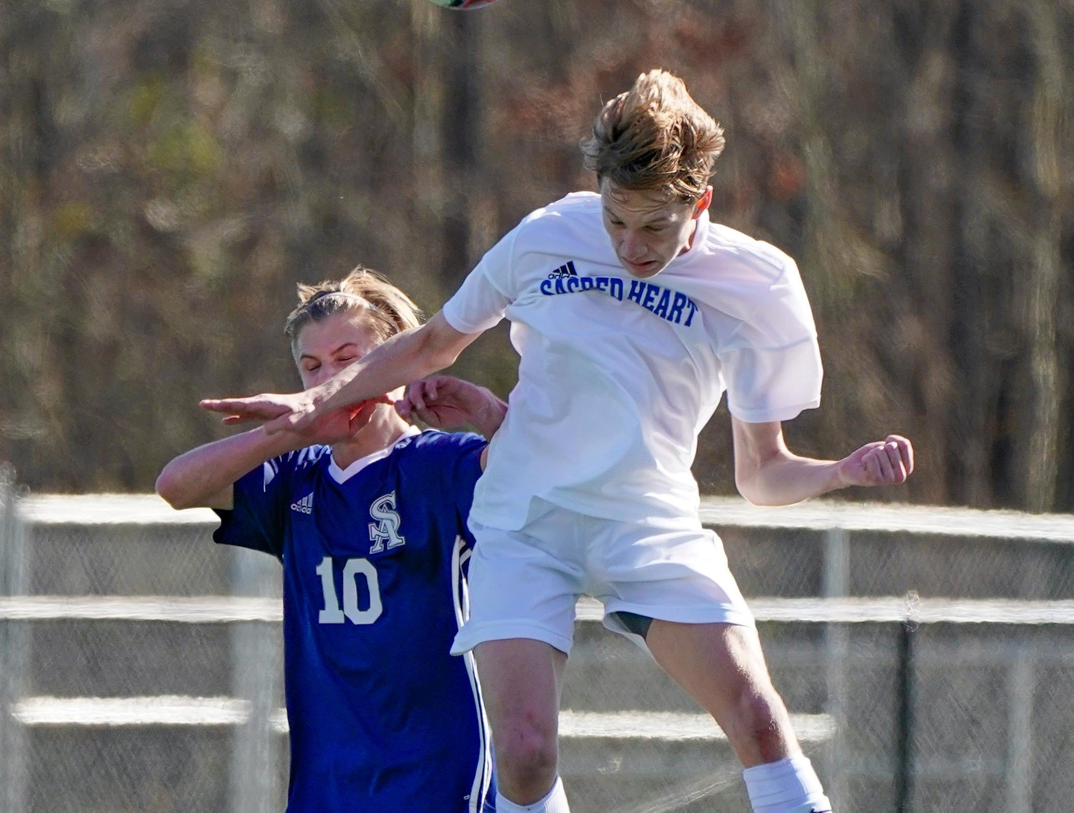 Sacred Heart's Heath Hogan (16) heads a ball against St. Andrew's Jackson Bataille (10) during the MHSAA 1A,2A,3A  Boys Soccer Championships held at Brandon High School in Brandon, MS, Saturday February 9, 2019.(Bob Smith-For The Clarion Ledger)