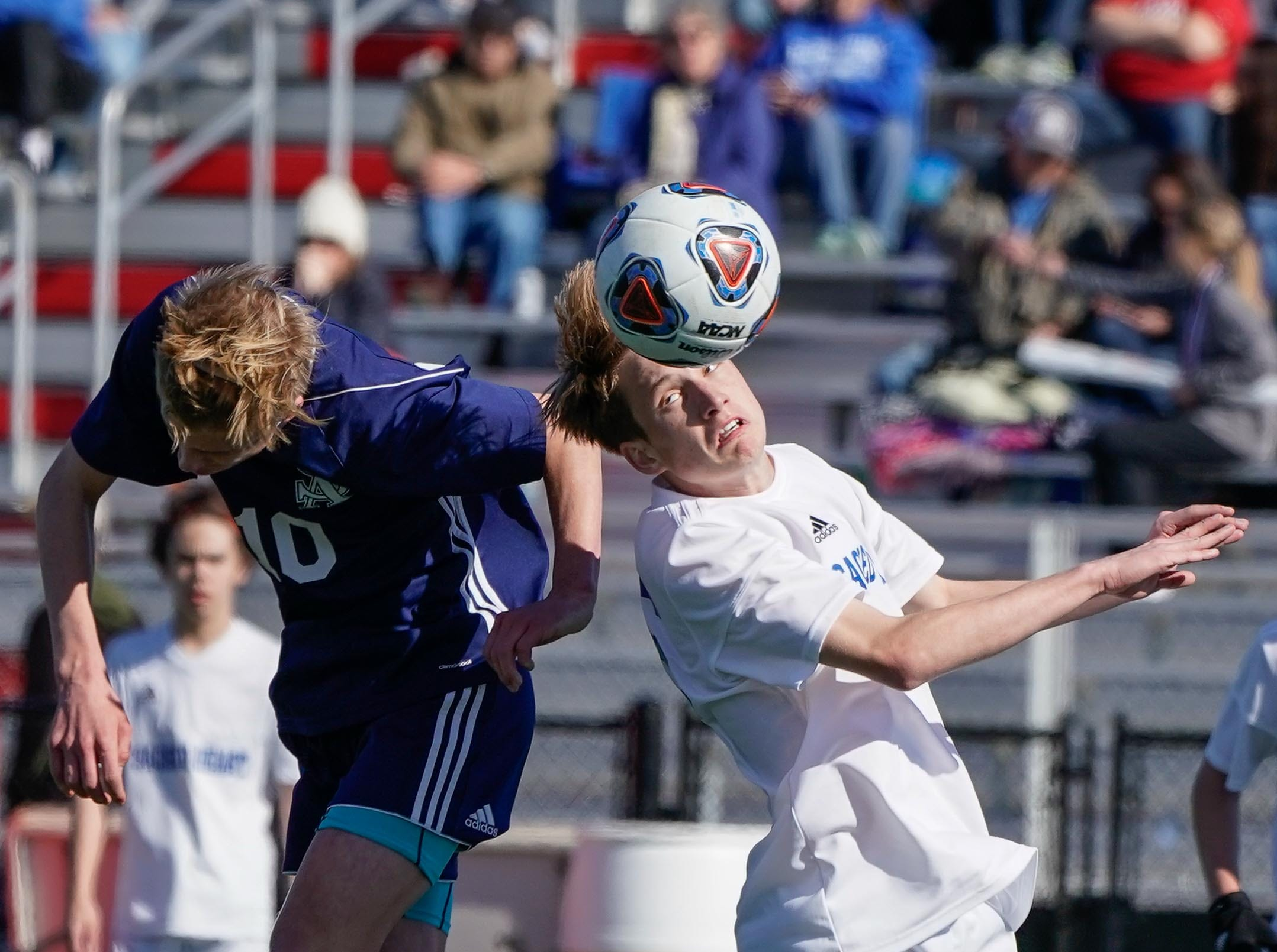 St. Andrew's Jackson Bataille (10) and Sacred Heart's Heath Hogan (16) fight for a ball during the MHSAA 1A,2A,3A  Boys Soccer Championships held at Brandon High School in Brandon, MS, Saturday February 9, 2019.(Bob Smith-For The Clarion Ledger)