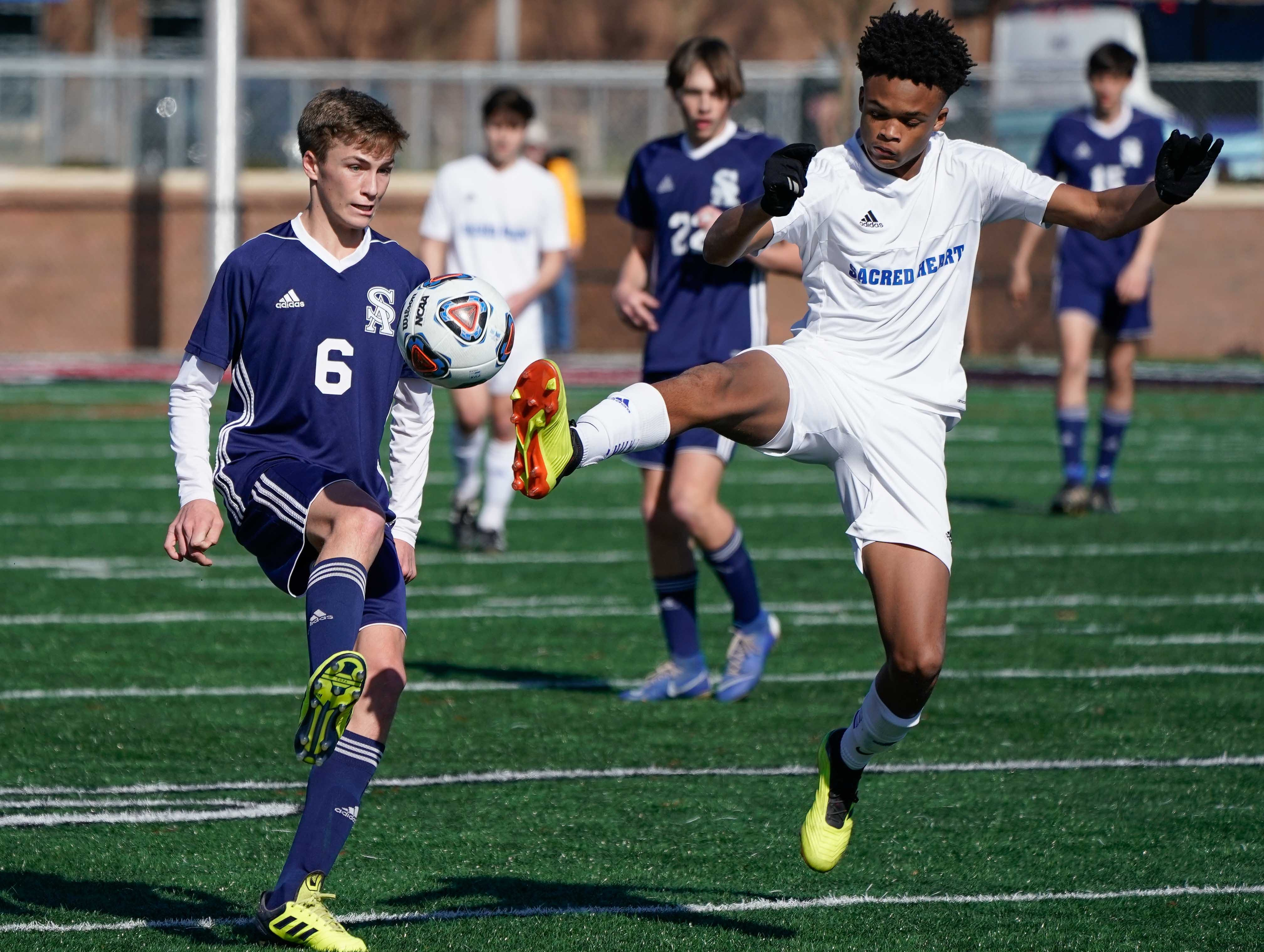 Sacred Heart's Byron Easterling (3) and St Andrew's Hudson Bataille (6) go for a ball during the MHSAA 1A,2A,3A  Boys Soccer Championships held at Brandon High School in Brandon, MS, Saturday February 9, 2019.(Bob Smith-For The Clarion Ledger)