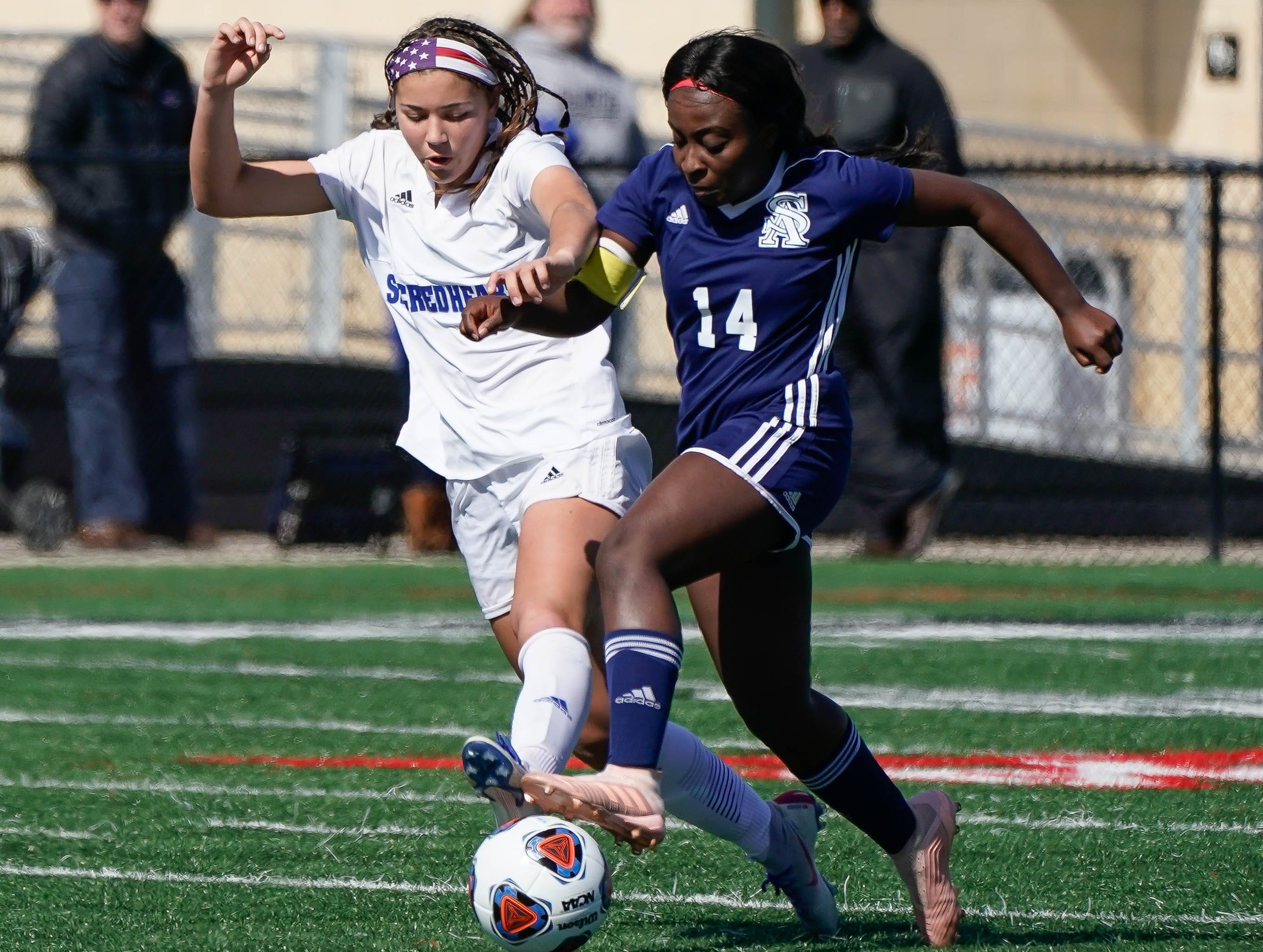 St. Andrew's Toni Oluwatade (14) battles against Sacred Heart's Graciella Falla (10) during the MHSAA 1A,2A,3A  GIrls Soccer Championships held at Brandon High School in Brandon, MS, Saturday February 9, 2019.(Bob Smith-For The Clarion Ledger)