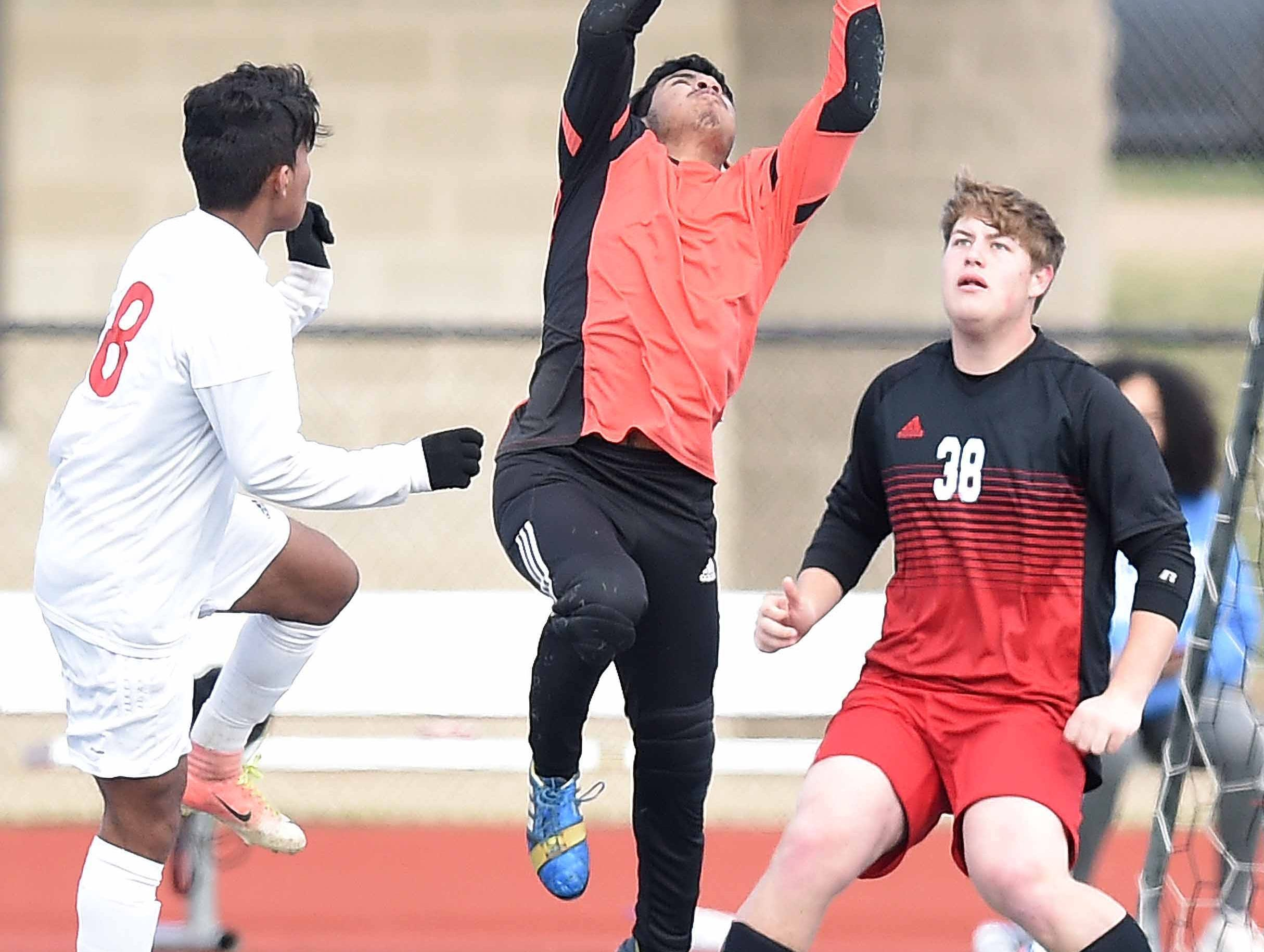 West Lauderdale's goalkeeper Ivan Betancourt leaps to make a save against Richland in the Class 4A state championship in the MHSAA BlueCross Blue Shield of Mississippi Soccer Classic on Saturday, February 9, 2019, at Ridgeland High School in Ridgeland, Miss.