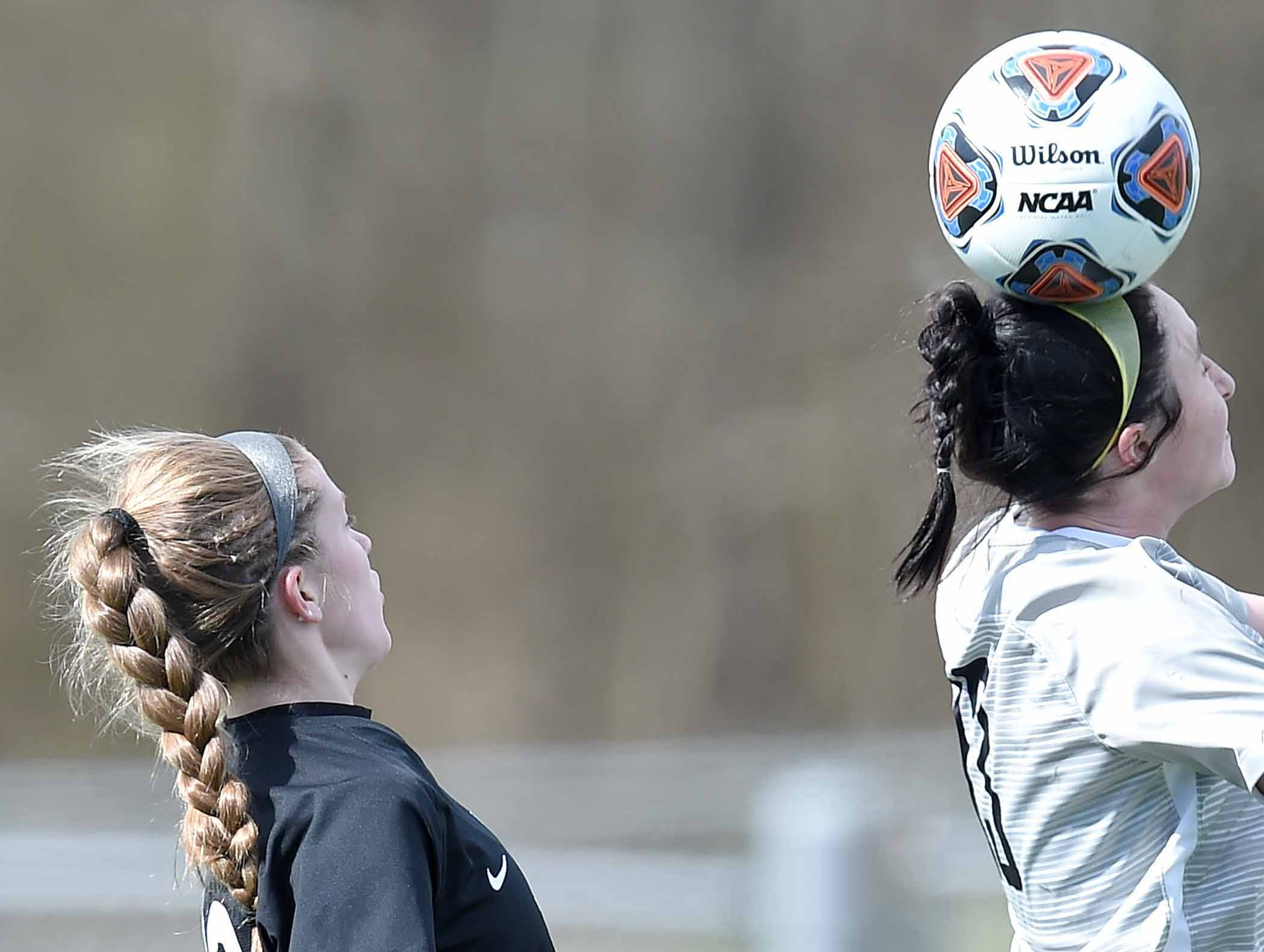 Florence's Grace Giglio (13) heads the ball against West Lauderdale in the Class 4A state championship in the MHSAA BlueCross Blue Shield of Mississippi Soccer Classic on Saturday, February 9, 2019, at Ridgeland High School in Ridgeland, Miss.