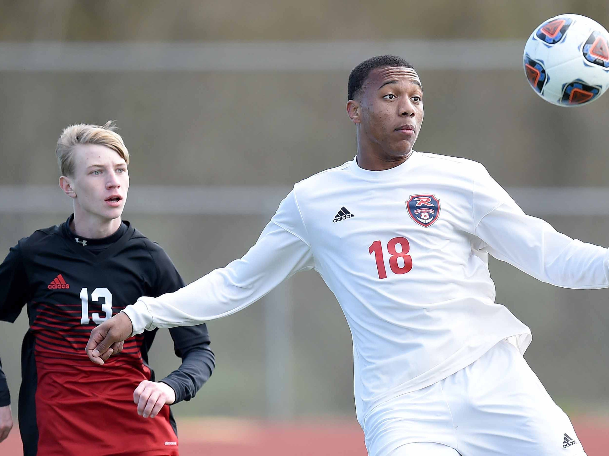 Richland's Greg Anderson (18) looks to clear the ball in front of West Lauderdale's Chance Davidson (13) in the Class 4A state championship in the MHSAA BlueCross Blue Shield of Mississippi Soccer Classic on Saturday, February 9, 2019, at Ridgeland High School in Ridgeland, Miss.