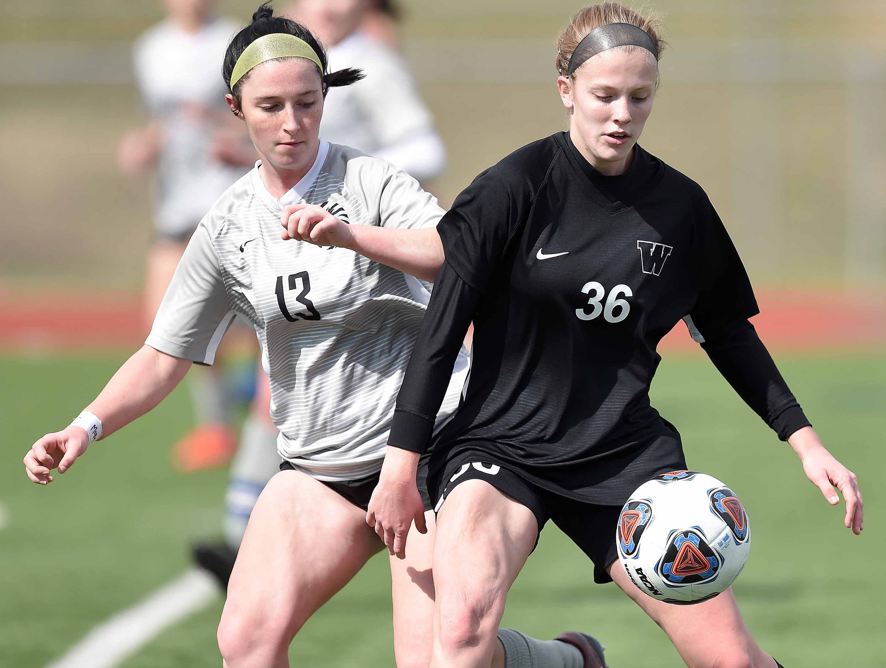 Florence's Grace Giglio (13) competes for the ball against West Lauderdale's Ember Temple (36) in the Class 4A state championship in the MHSAA BlueCross Blue Shield of Mississippi Soccer Classic on Saturday, February 9, 2019, at Ridgeland High School in Ridgeland, Miss.
