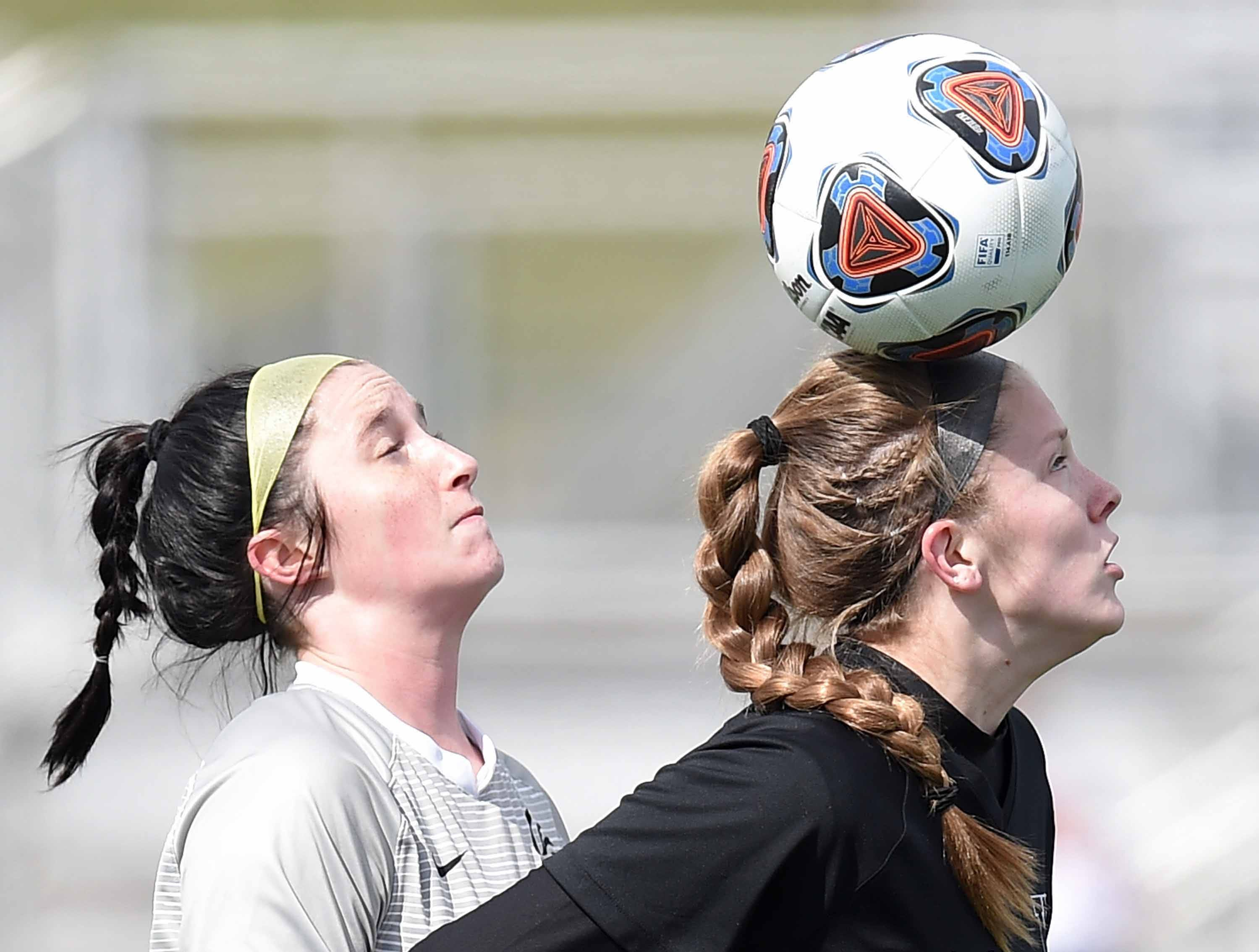 West Lauderdale's Ember Temple (right) heads the ball against Florence in the Class 4A state championship in the MHSAA BlueCross Blue Shield of Mississippi Soccer Classic on Saturday, February 9, 2019, at Ridgeland High School in Ridgeland, Miss.