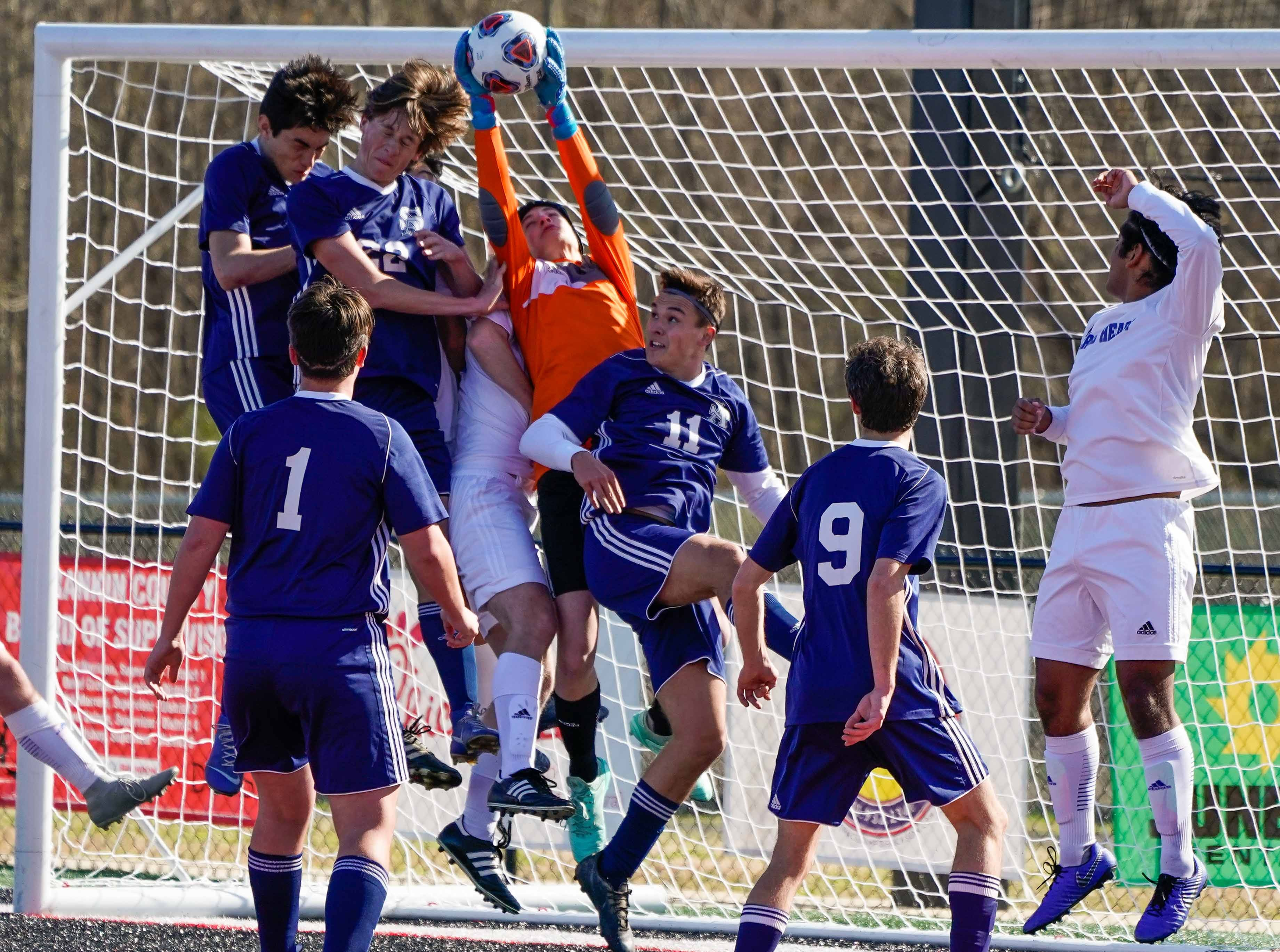 Sacred Heart keeper Jacob Painter saves a ball against a host of St Andrew's players during the MHSAA 1A,2A,3A  Boys Soccer Championships held at Brandon High School in Brandon, MS, Saturday February 9, 2019.(Bob Smith-For The Clarion Ledger)