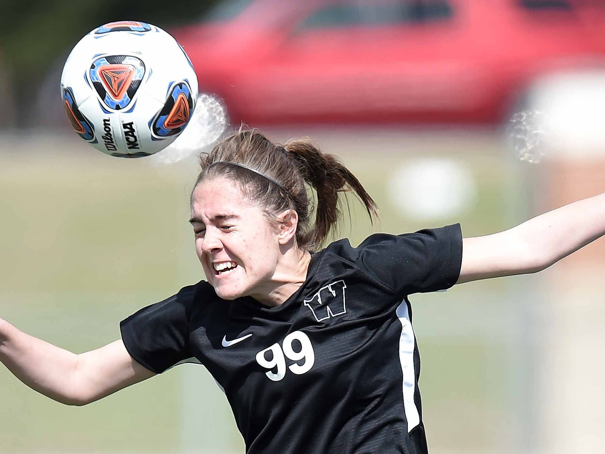 West Lauderdale's Kathryn Knuth (99) heads the ball against Florence in the Class 4A state championship in the MHSAA BlueCross Blue Shield of Mississippi Soccer Classic on Saturday, February 9, 2019, at Ridgeland High School in Ridgeland, Miss.