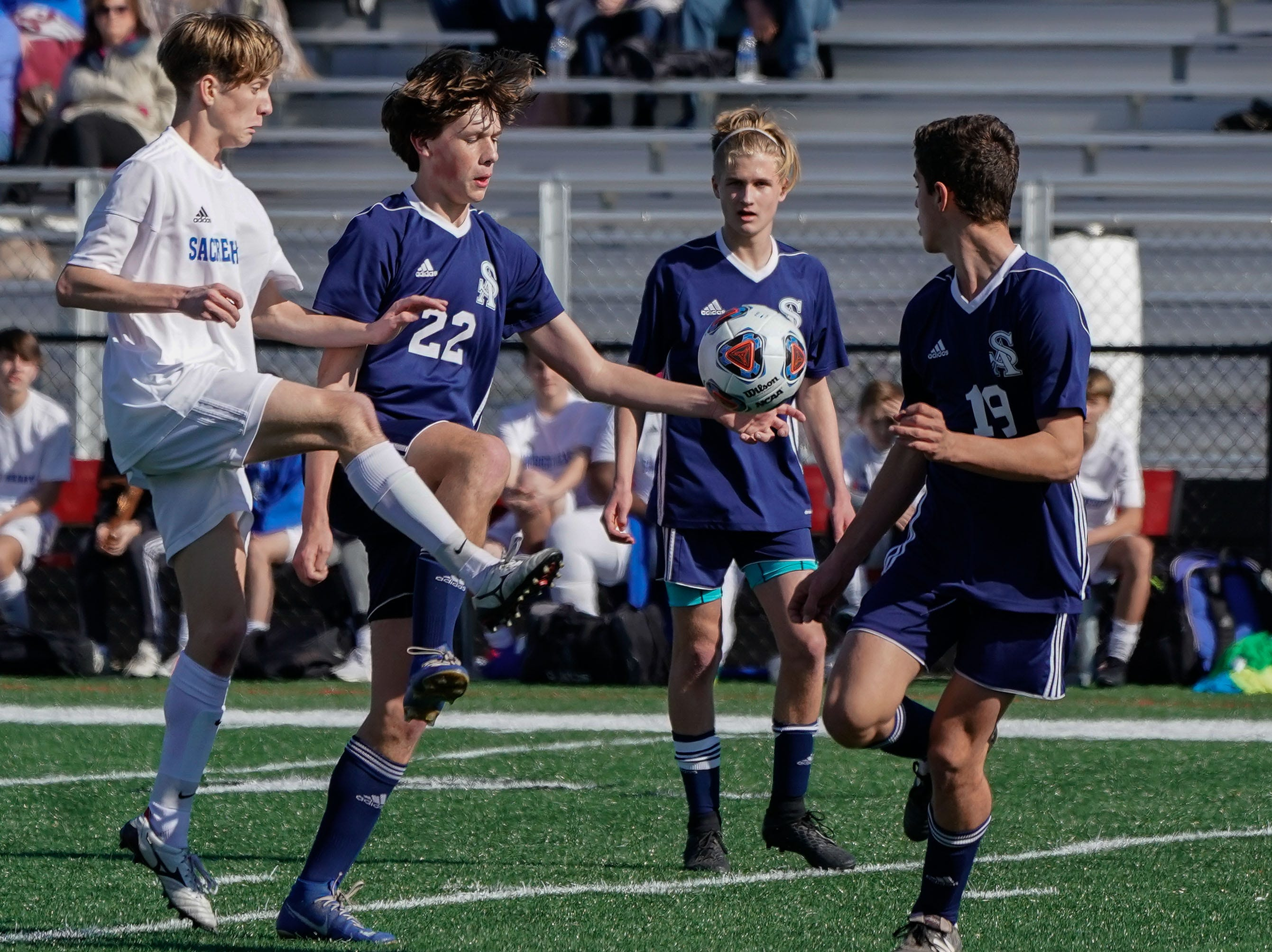 St. Andrew's Chadwick Collins (22) tries to control a ball against Sacred Heart's Heath Hogan (16) during the MHSAA 1A,2A,3A  Boys Soccer Championships held at Brandon High School in Brandon, MS, Saturday February 9, 2019.(Bob Smith-For The Clarion Ledger)