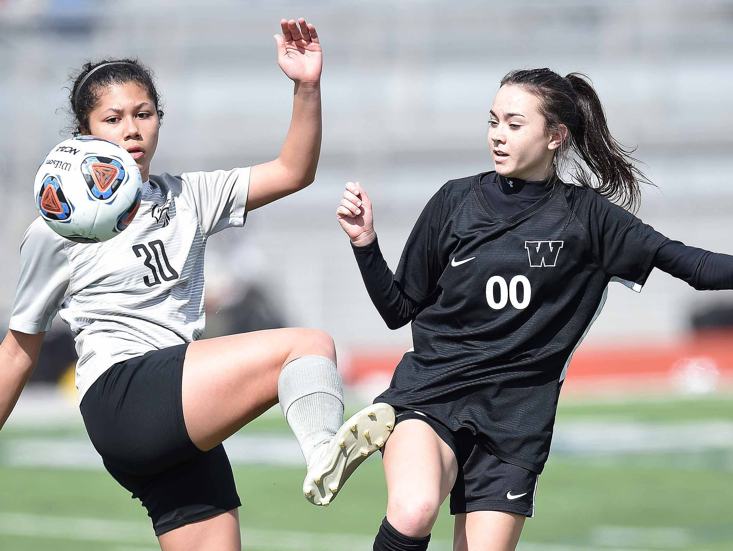 Florence's Shaelynn Quick (30) and West Lauderdale's Mikaela Morrison (00) compete for a ball at midfield in the Class 4A state championship in the MHSAA BlueCross Blue Shield of Mississippi Soccer Classic on Saturday, February 9, 2019, at Ridgeland High School in Ridgeland, Miss.