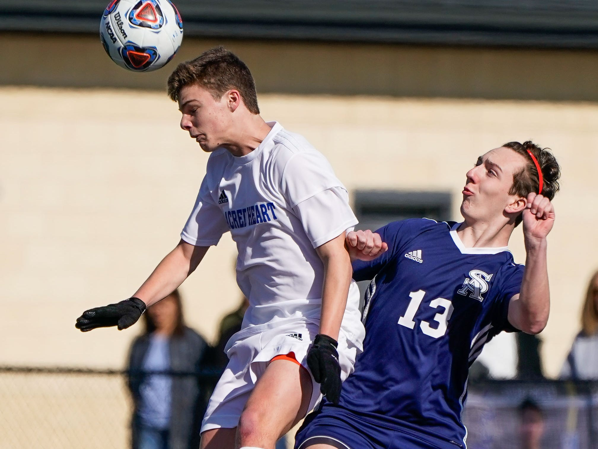 St. Andrew's John Mychal Warren (13) and Sacred Heart's Bennett Gibson (28) battle for a header during the MHSAA 1A,2A,3A  Boys Soccer Championships held at Brandon High School in Brandon, MS, Saturday February 9, 2019.(Bob Smith-For The Clarion Ledger)