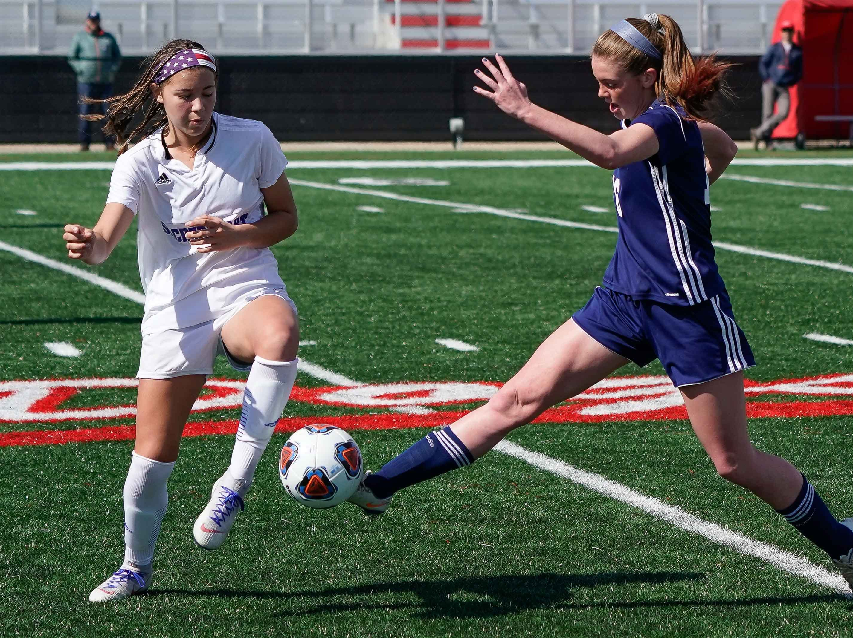 St. Andrew's Mary Reagan Barnett (16) kicks a ball against Sacred Heart's Graciella Falla (10) Sacred Heart during the MHSAA 1A,2A,3A  GIrls Soccer Championships held at Brandon High School in Brandon, MS, Saturday February 9, 2019.(Bob Smith-For The Clarion Ledger)