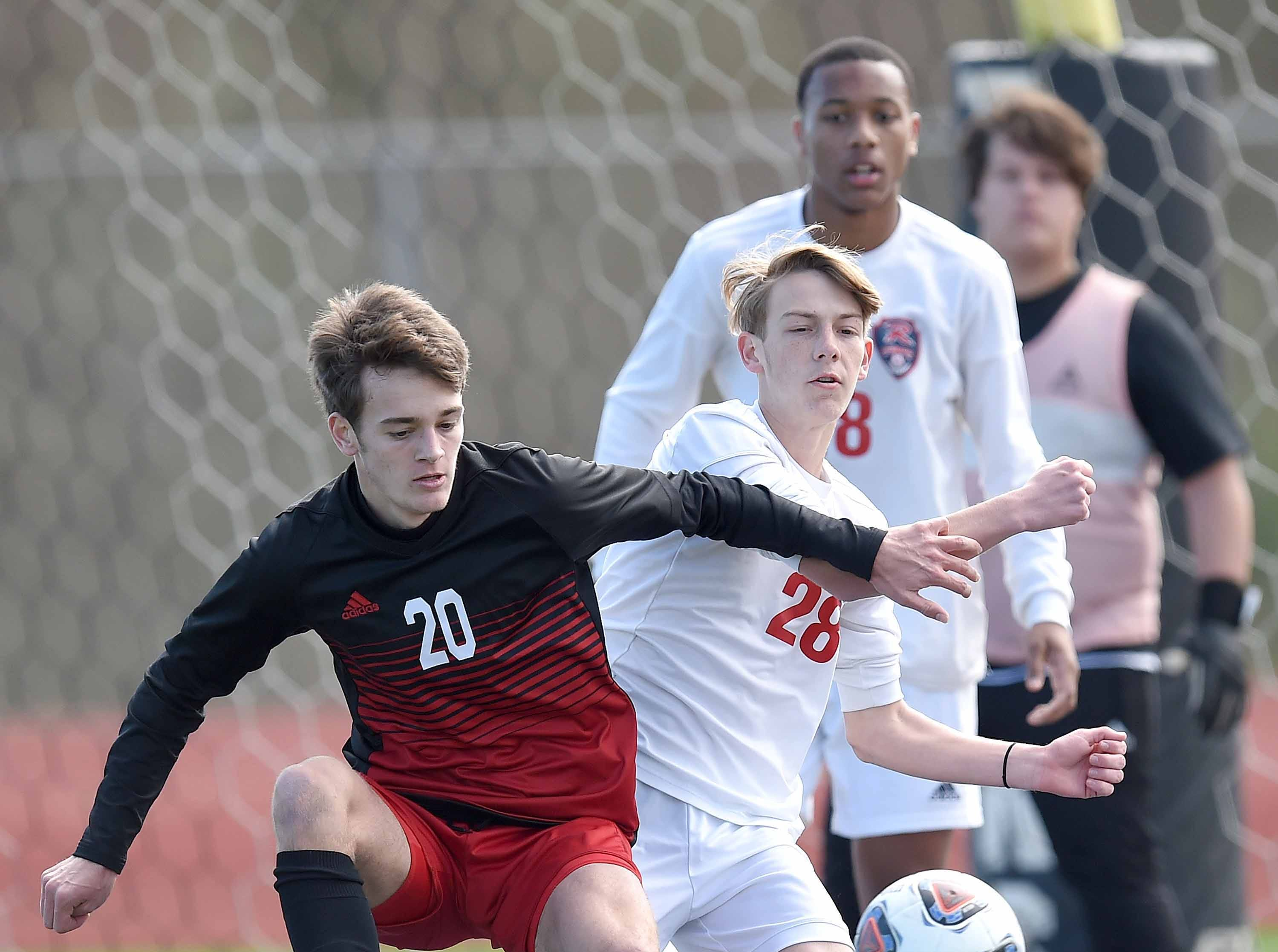 West Lauderdale's Jack Green (20) competes for a ball against Richland's Thomas Roberts (28) in the Class 4A state championship in the MHSAA BlueCross Blue Shield of Mississippi Soccer Classic on Saturday, February 9, 2019, at Ridgeland High School in Ridgeland, Miss.