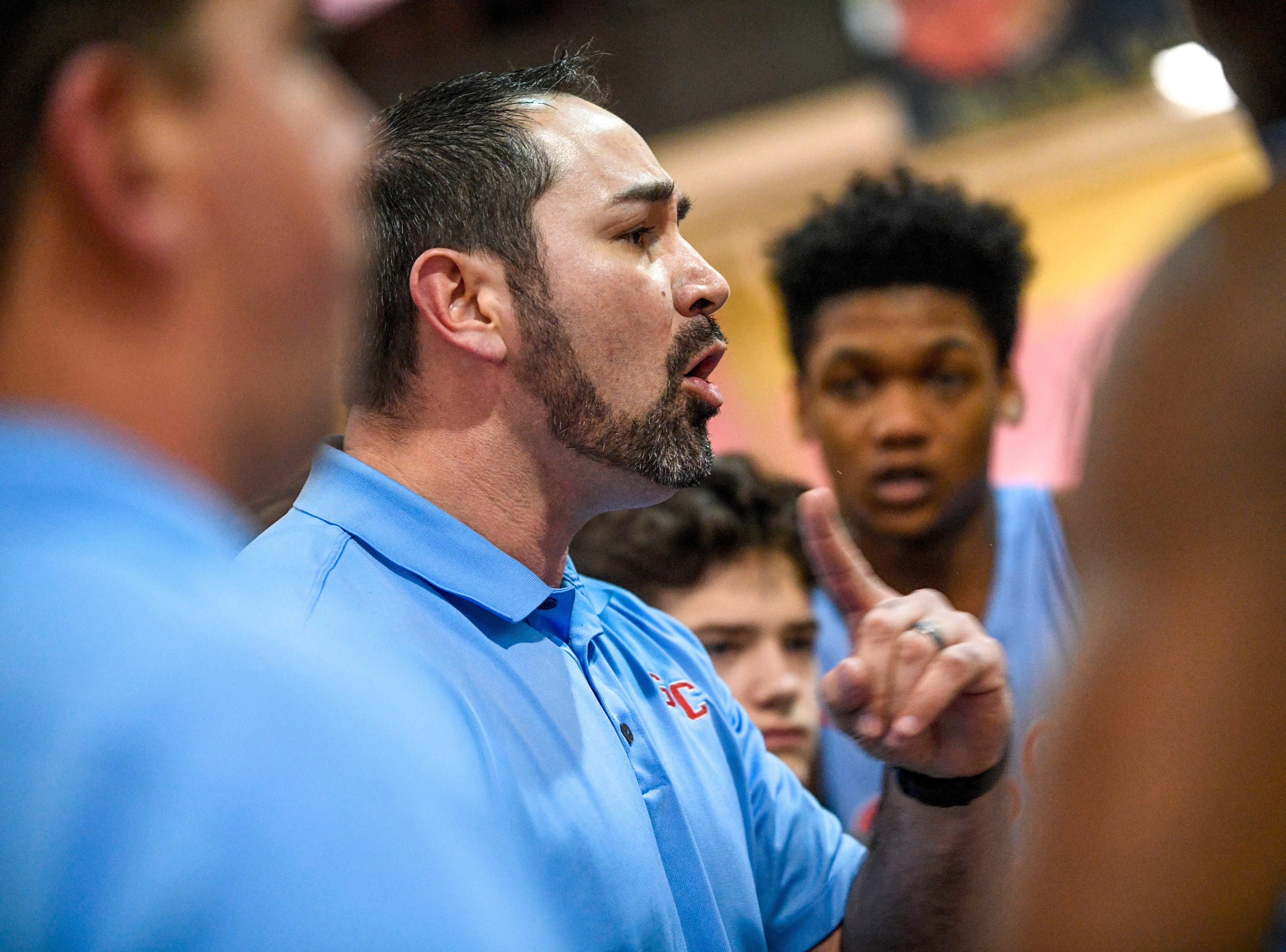 Gibson County head coach Justin Lowery speaks to his players in a timeout in a TSSAA basketball game between Peabody and Gibson County at Peabody High School in Trenton, Tenn., on Friday, Feb. 8, 2019.