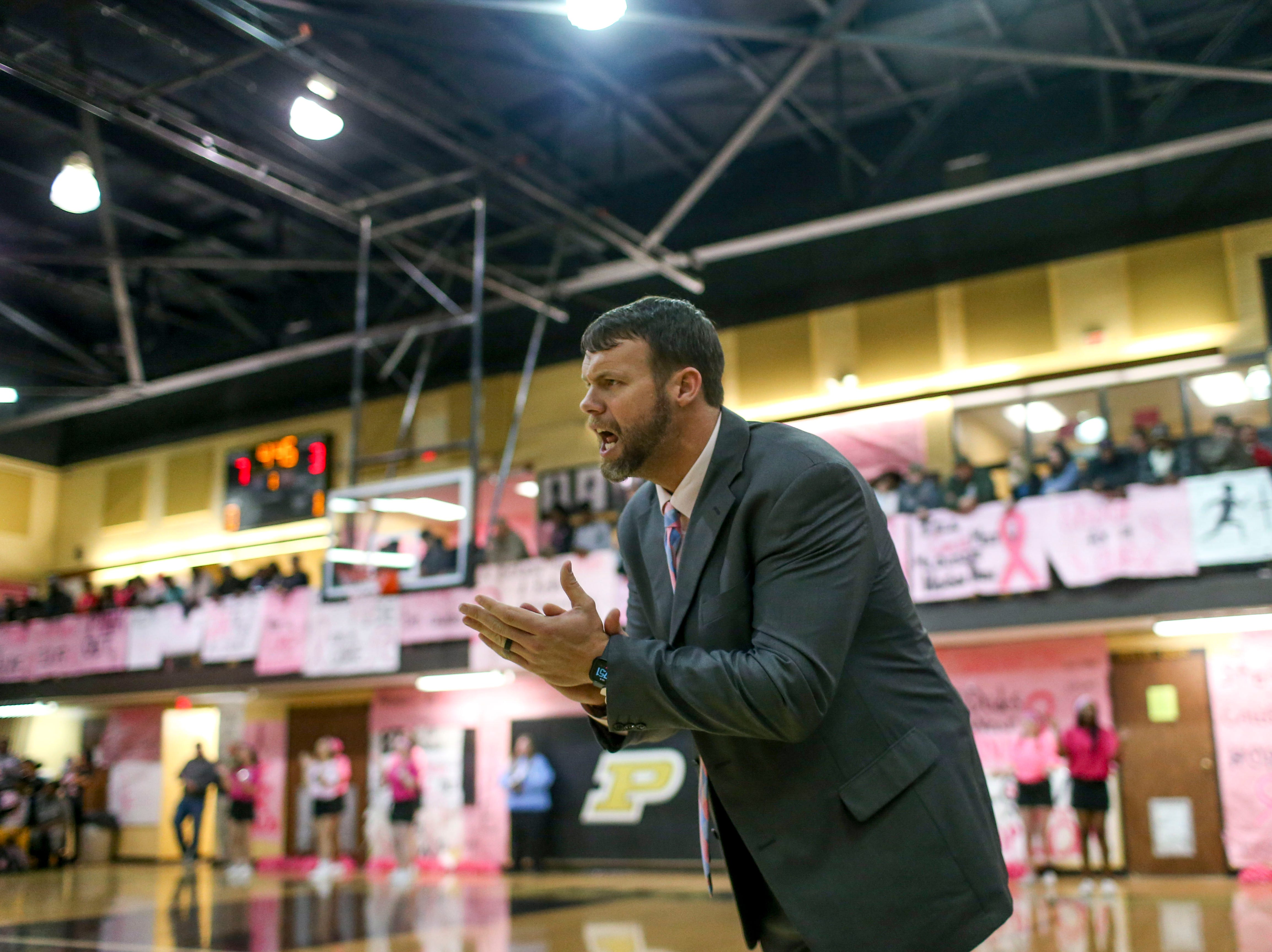 Peabody head coach Miller cheers his players on in a TSSAA basketball game between Peabody and Gibson County at Peabody High School in Trenton, Tenn., on Friday, Feb. 8, 2019.