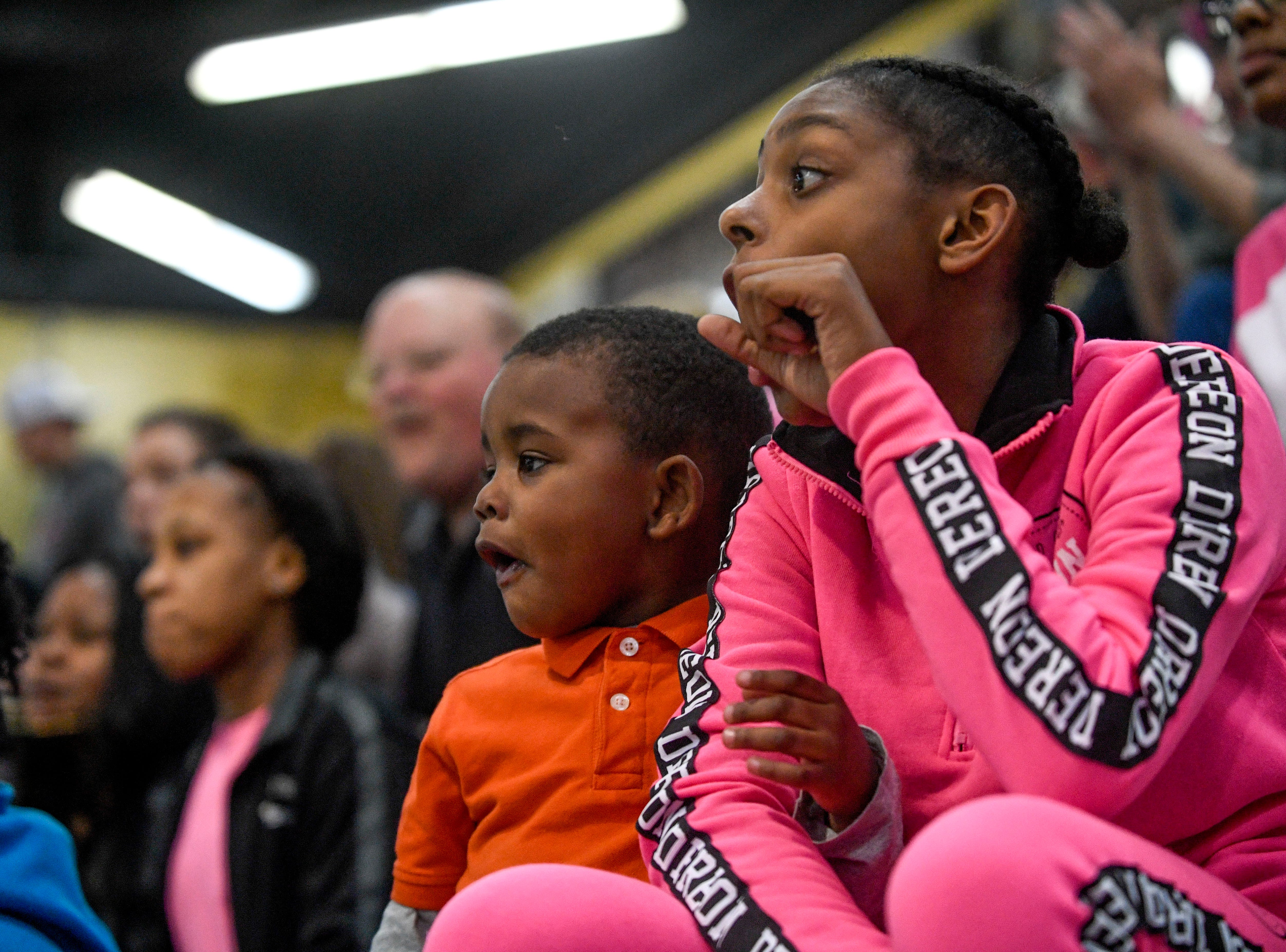 Peabody fans Layten Tucker, 3, left, and Khalia Vanburen, 12, right, react after a fan makes a half court shot during half time in a TSSAA basketball game between Peabody and Gibson County at Peabody High School in Trenton, Tenn., on Friday, Feb. 8, 2019.
