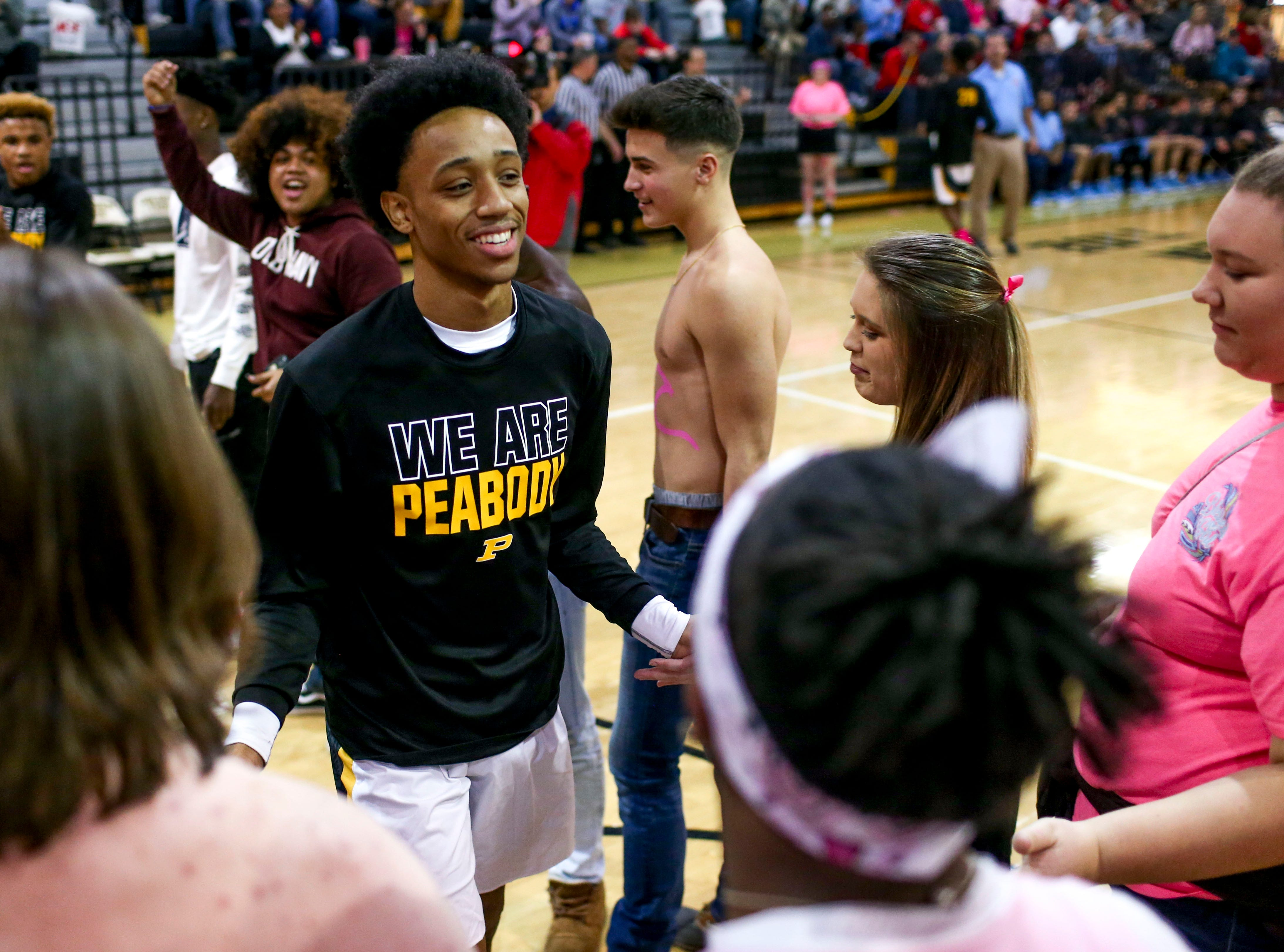 Peabody's Ja'Darius Harris (1) enters the game to fanfare from fans and teammates in a TSSAA basketball game between Peabody and Gibson County at Peabody High School in Trenton, Tenn., on Friday, Feb. 8, 2019.
