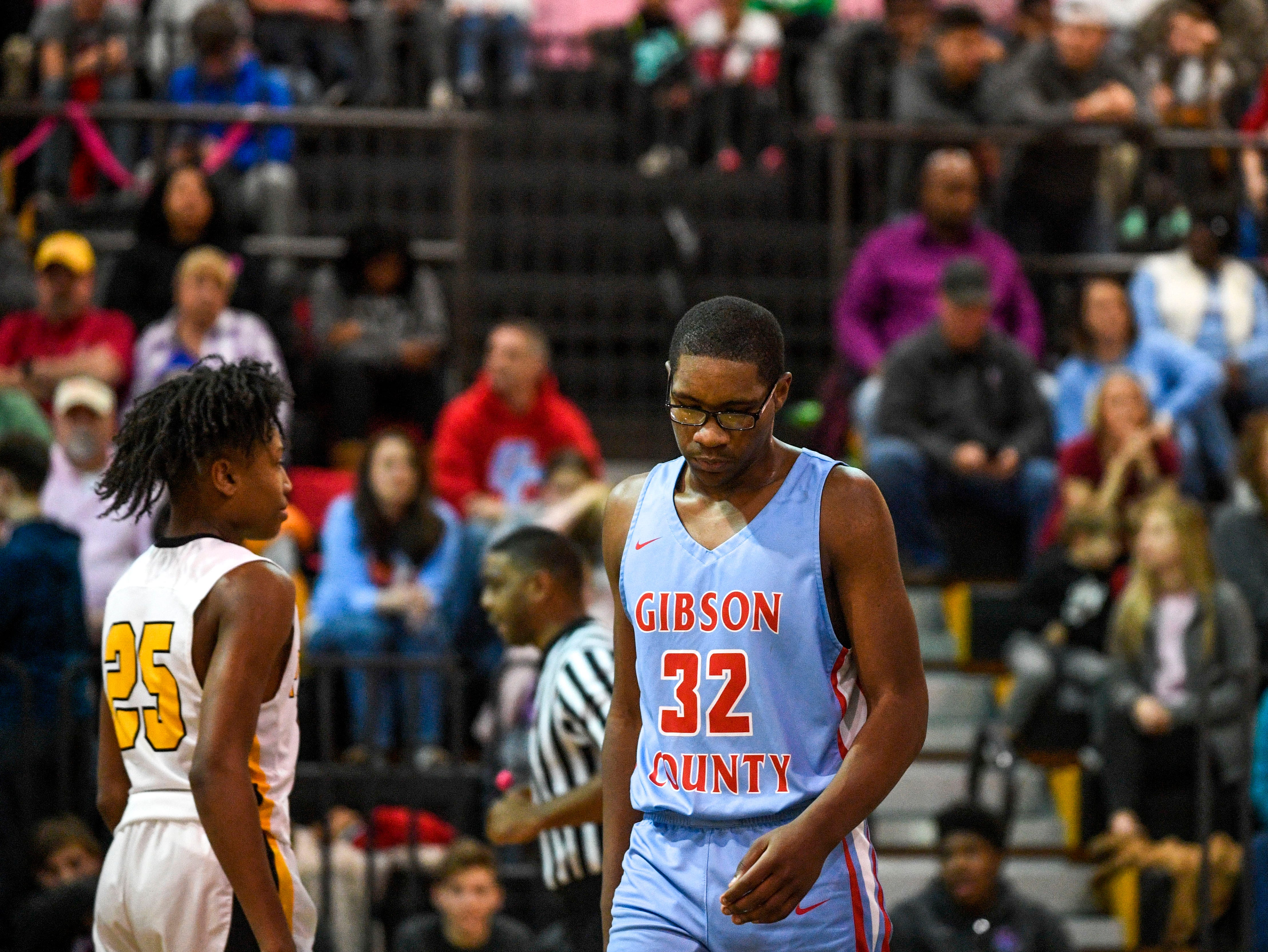 Gibson County's Jarvis Myers (32) walks back down the court with his head down in a TSSAA basketball game between Peabody and Gibson County at Peabody High School in Trenton, Tenn., on Friday, Feb. 8, 2019.