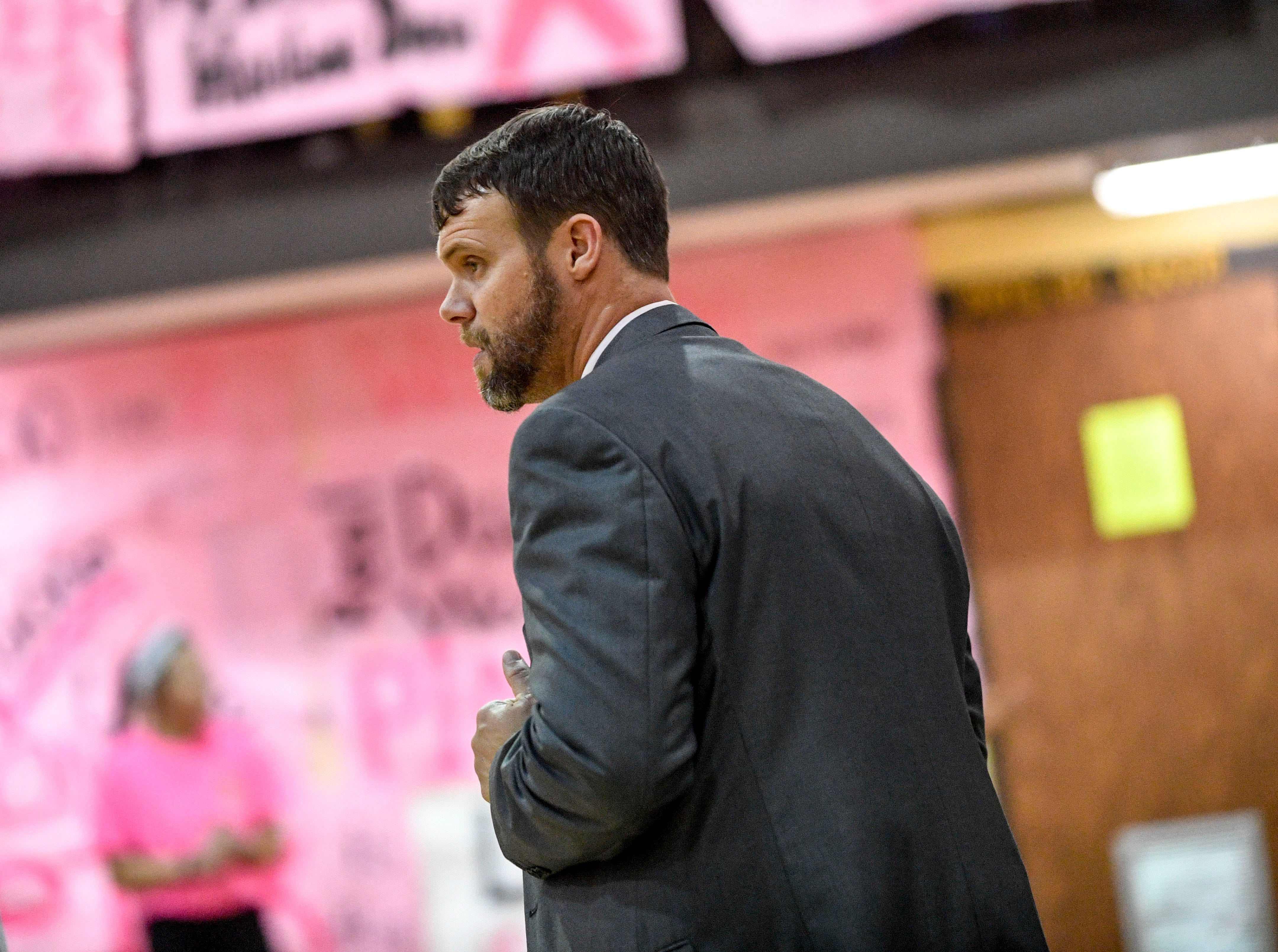 Peabody head coach Miller walks the sideline of his players in a TSSAA basketball game between Peabody and Gibson County at Peabody High School in Trenton, Tenn., on Friday, Feb. 8, 2019.