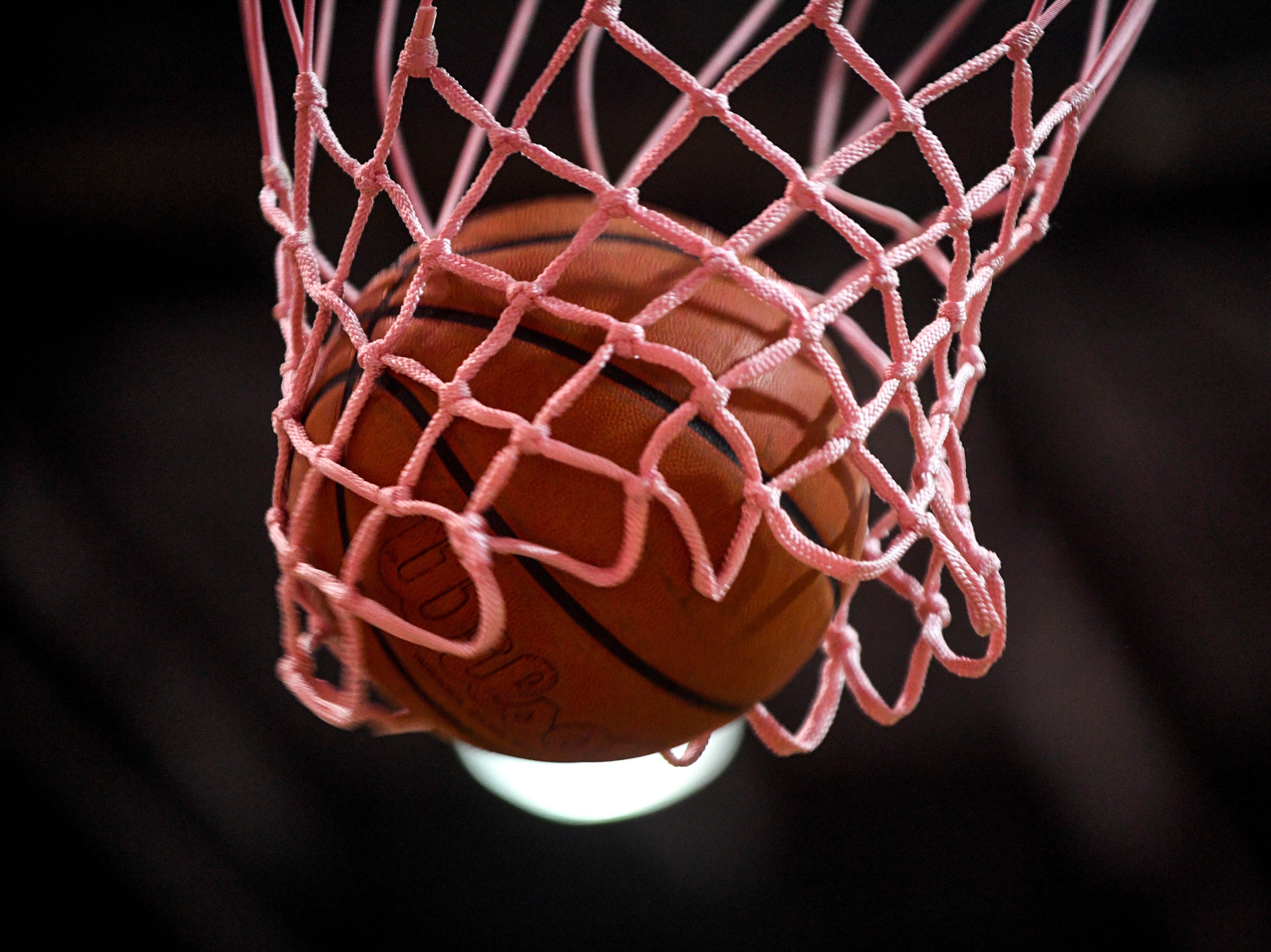 A basketball lands in the net during a TSSAA basketball game between Peabody and Gibson County at Peabody High School in Trenton, Tenn., on Friday, Feb. 8, 2019.