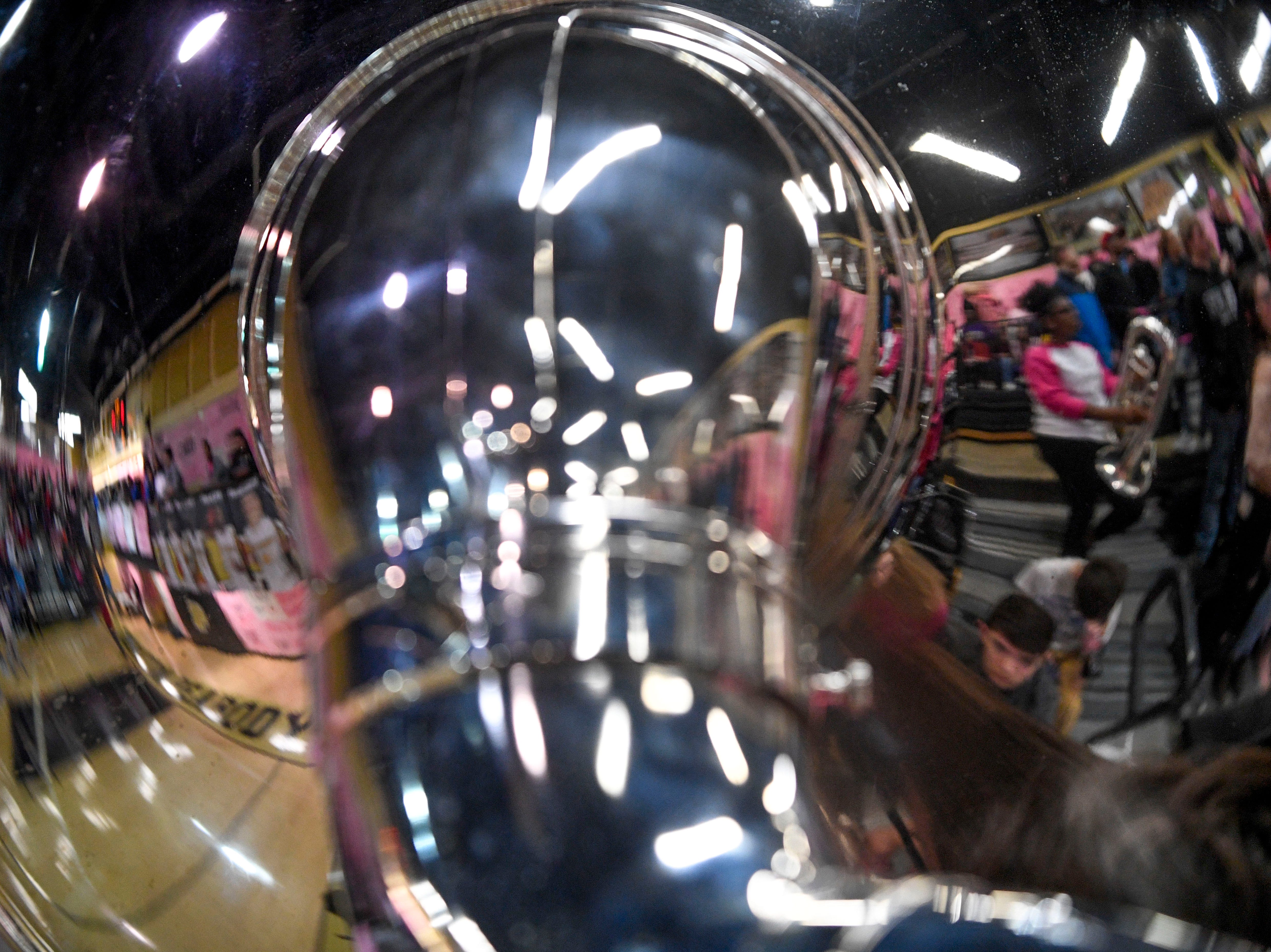 Fans and band members reflect in a sousaphone in a TSSAA basketball game between Peabody and Gibson County at Peabody High School in Trenton, Tenn., on Friday, Feb. 8, 2019.