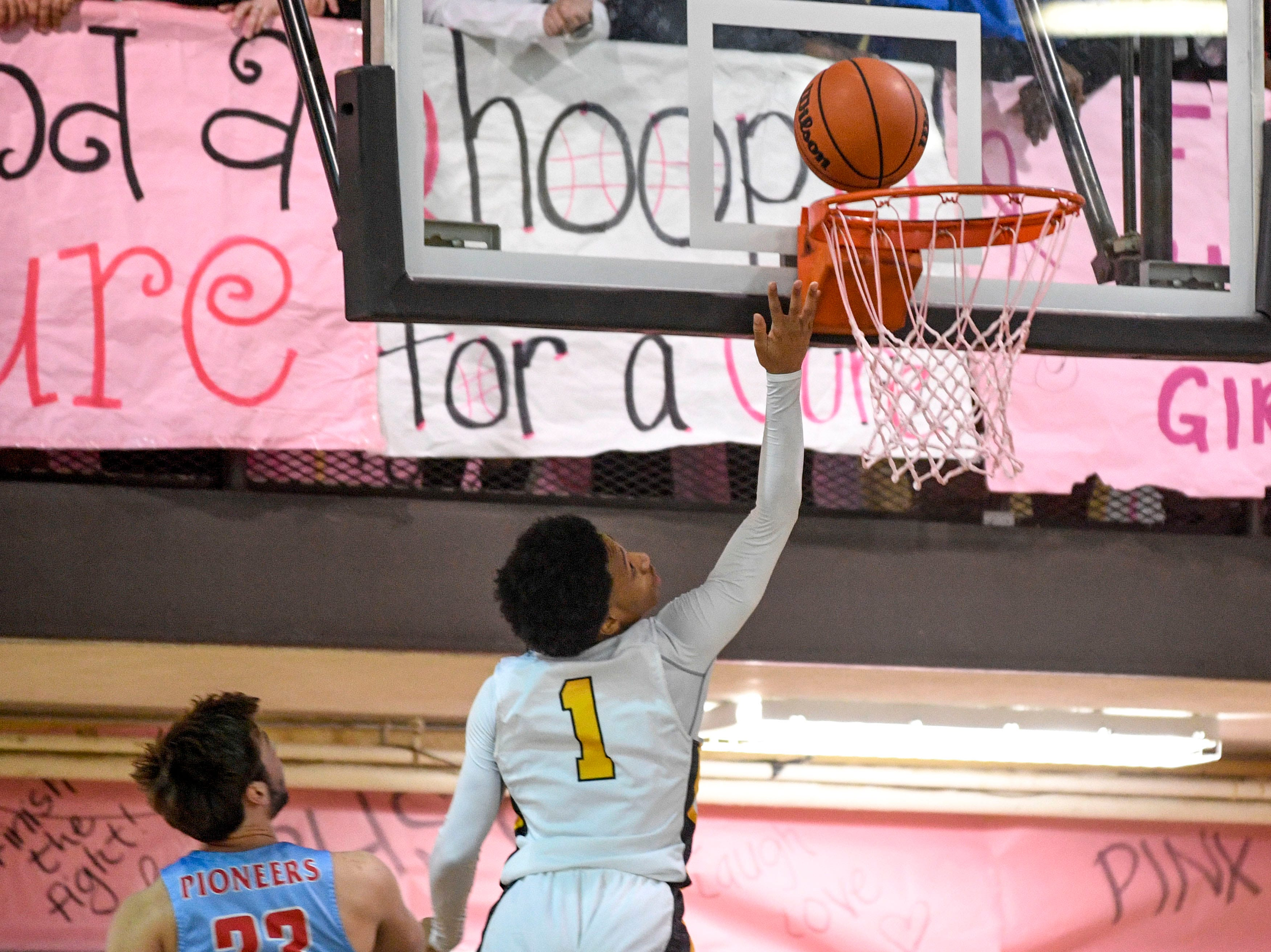 Peabody's Ja'Darius Harris (1) jumps up to shoot a layup in a TSSAA basketball game between Peabody and Gibson County at Peabody High School in Trenton, Tenn., on Friday, Feb. 8, 2019.