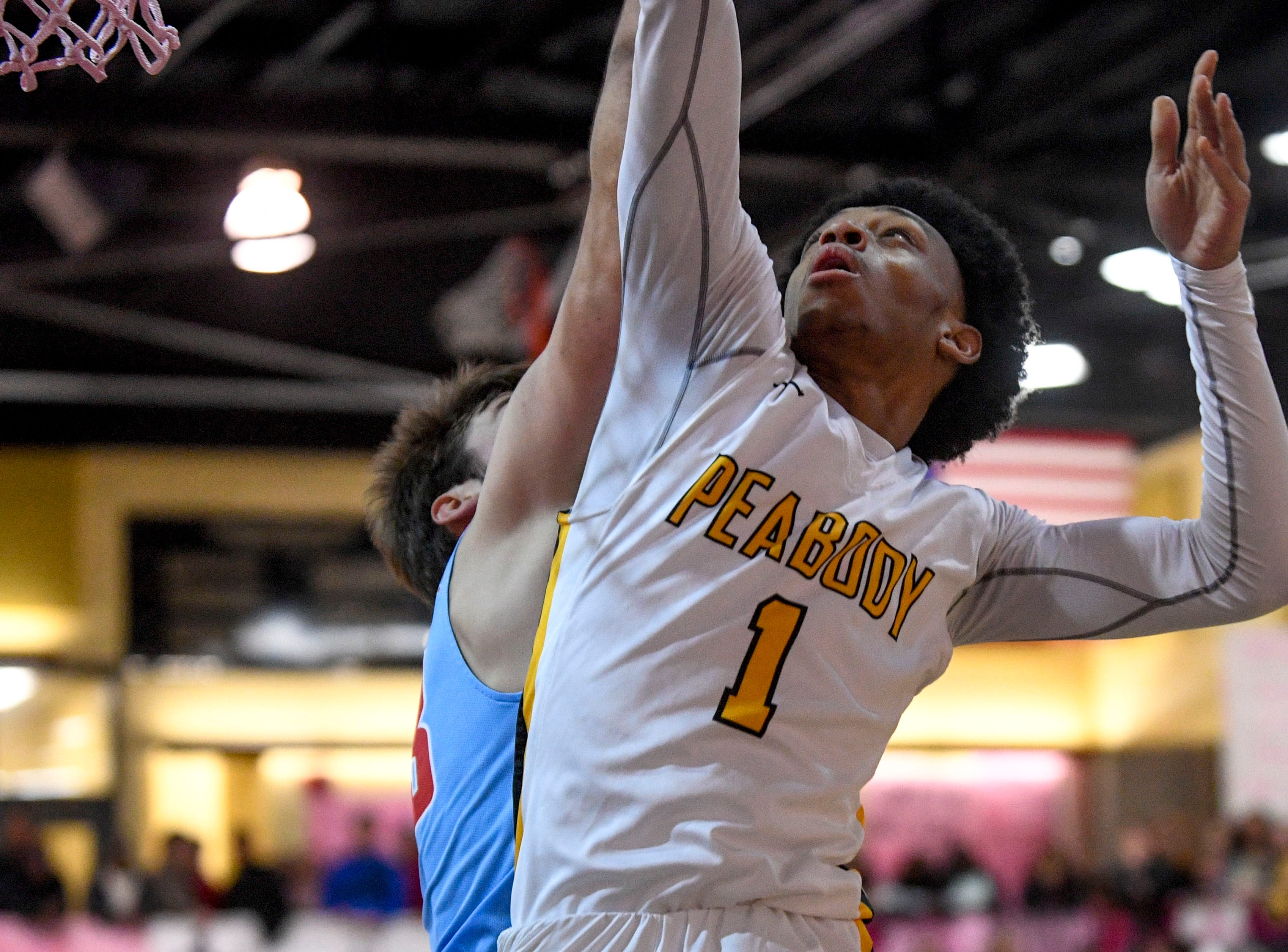 Peabody's Ja'Darius Harris (1) jumps to shoot a layup in a TSSAA basketball game between Peabody and Gibson County at Peabody High School in Trenton, Tenn., on Friday, Feb. 8, 2019.