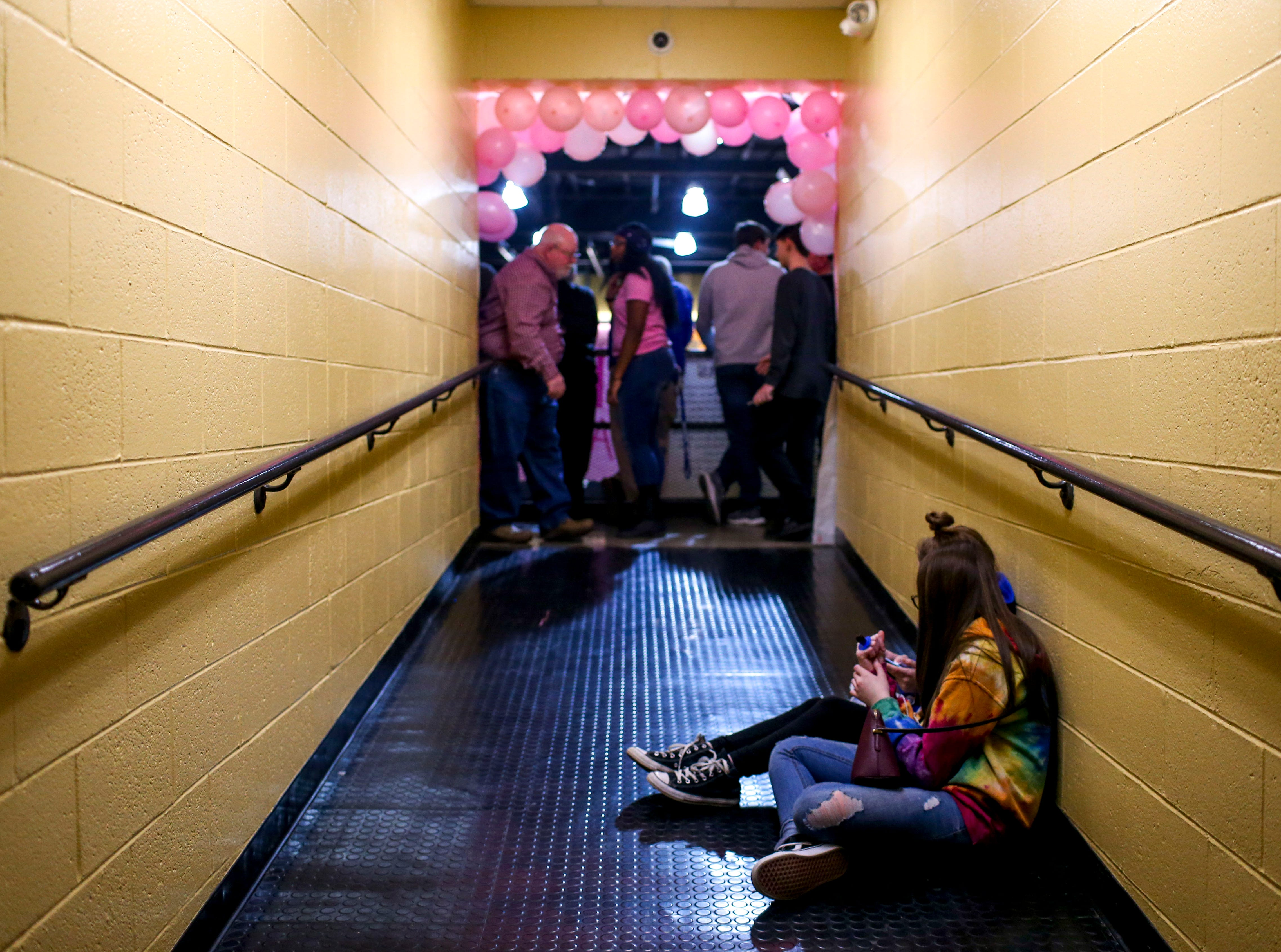 Game attendees hang out in a side hallway before the start of a TSSAA basketball game between Peabody and Gibson County at Peabody High School in Trenton, Tenn., on Friday, Feb. 8, 2019.