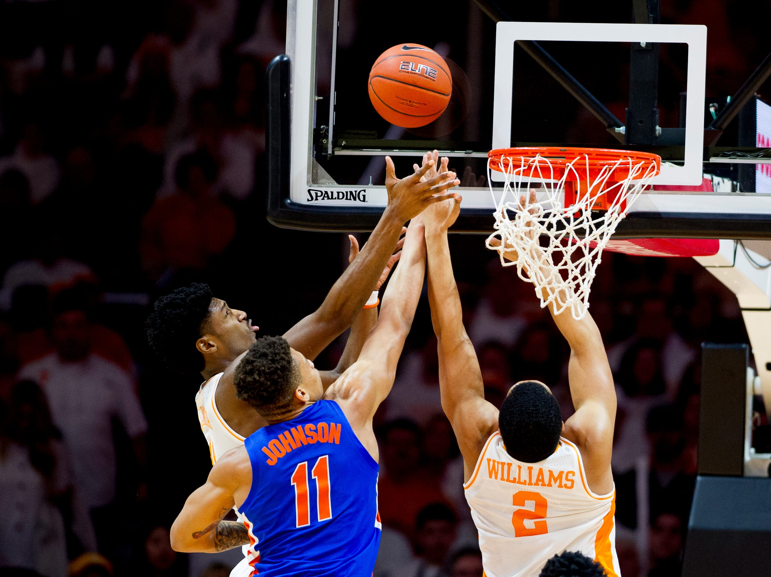 Tennessee forward Kyle Alexander (11), Florida forward Keyontae Johnson (11) and Tennessee forward Grant Williams (2) reach for a rebound ball during a game between Tennessee and Florida at Thompson-Boling Arena in Knoxville, Tennessee on Saturday, February 9, 2019.