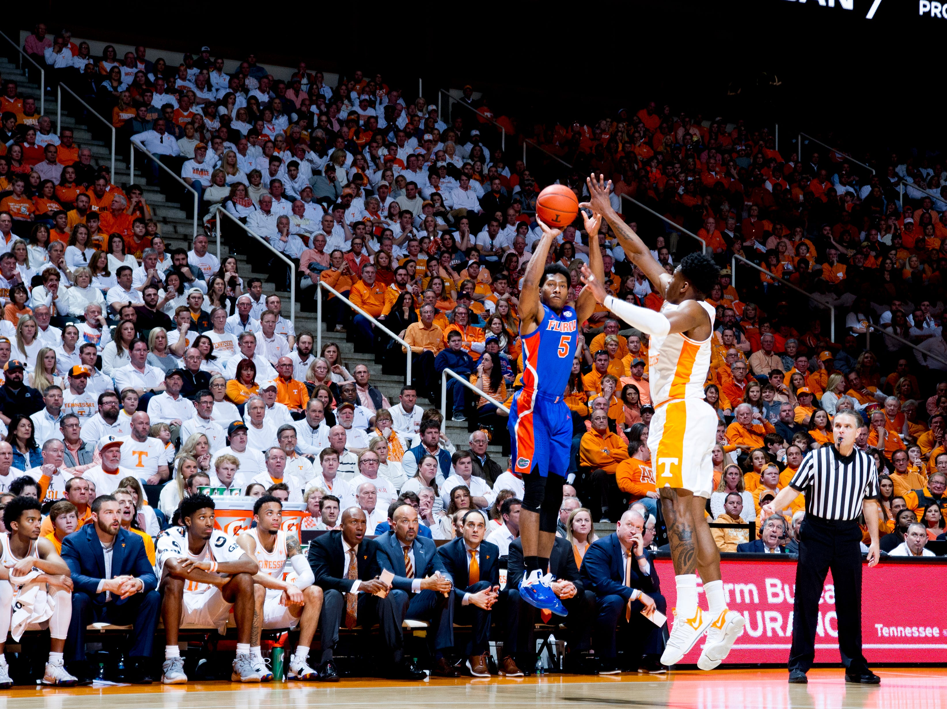 Florida guard KeVaughn Allen (5) shoots the ball as Tennessee guard Admiral Schofield (5) defend during a game between Tennessee and Florida at Thompson-Boling Arena in Knoxville, Tennessee on Saturday, February 9, 2019.