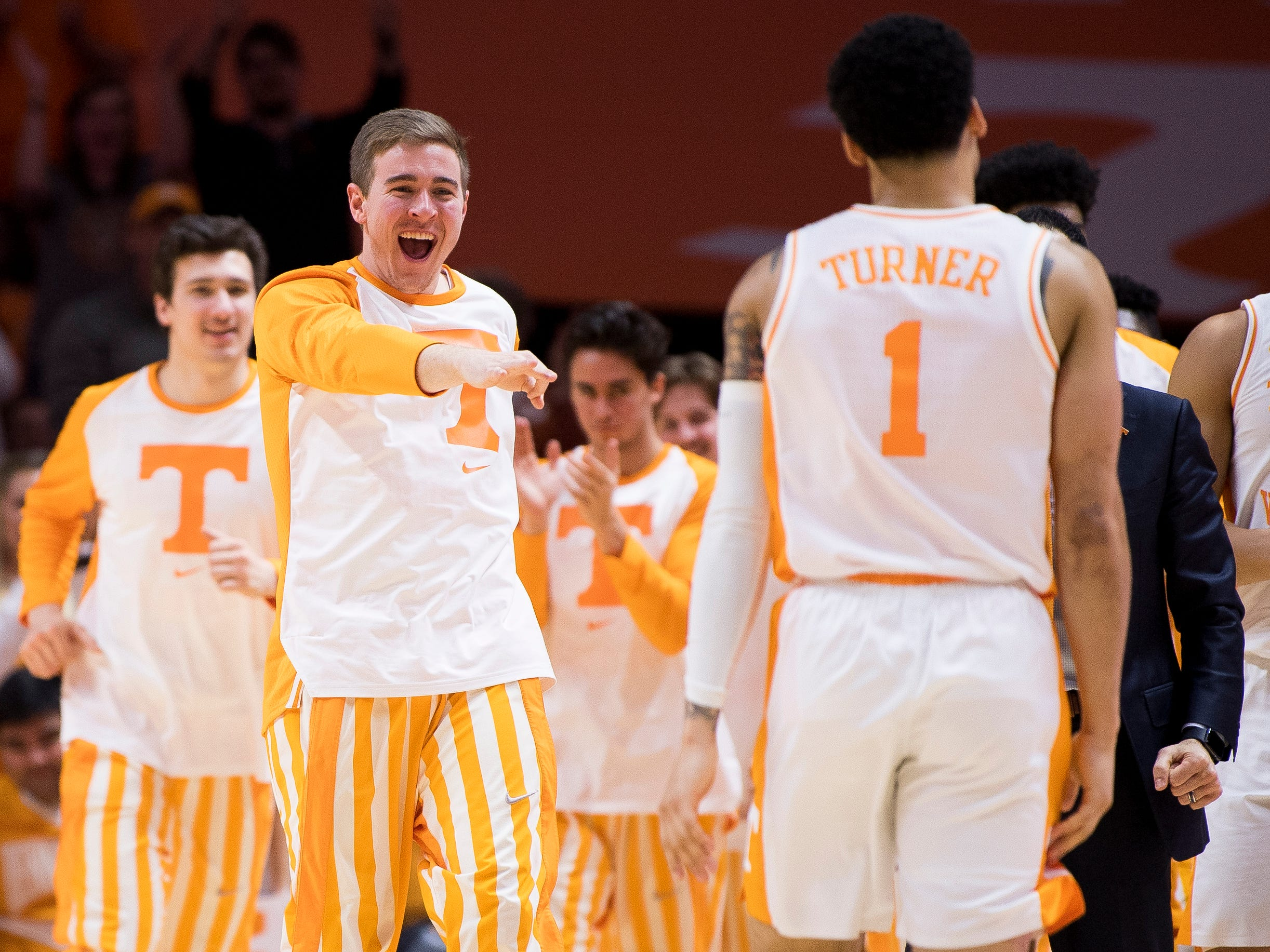 Tennessee guard Brad Woodson (12) celebrates as Tennessee takes a timeout during Tennessee's home SEC conference game against Florida at Thompson-Boling Arena in Knoxville on Saturday, February 9, 2019.