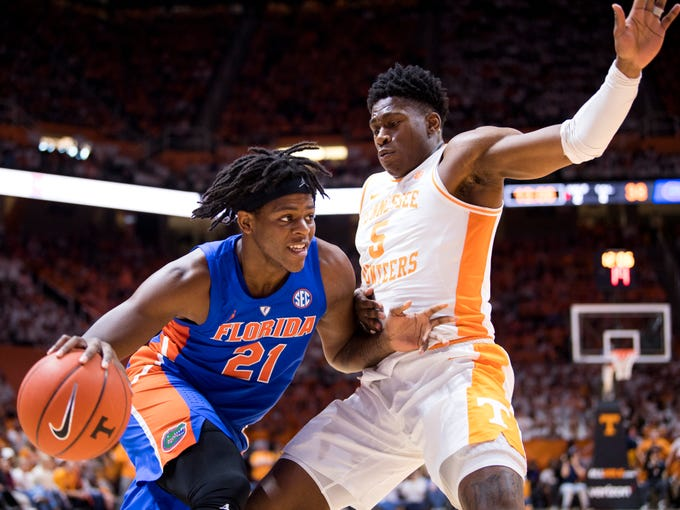Tennessee guard Admiral Schofield (5) defends Florida forward Dontay Bassett (21) during Tennessee's home SEC conference game against Florida at Thompson-Boling Arena in Knoxville on Saturday, February 9, 2019.