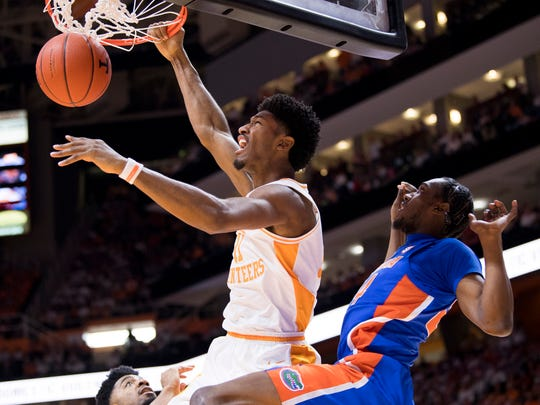 Tennessee forward Kyle Alexander (11) dunks the ball during Tennessee's home SEC conference game against Florida at Thompson-Boling Arena in Knoxville on Saturday, February 9, 2019.