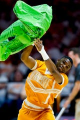 A Tennessee cheerleader beats up an alligator floatie during a game between Tennessee and Florida at Thompson-Boling Arena in Knoxville, Tennessee on Saturday, February 9, 2019.