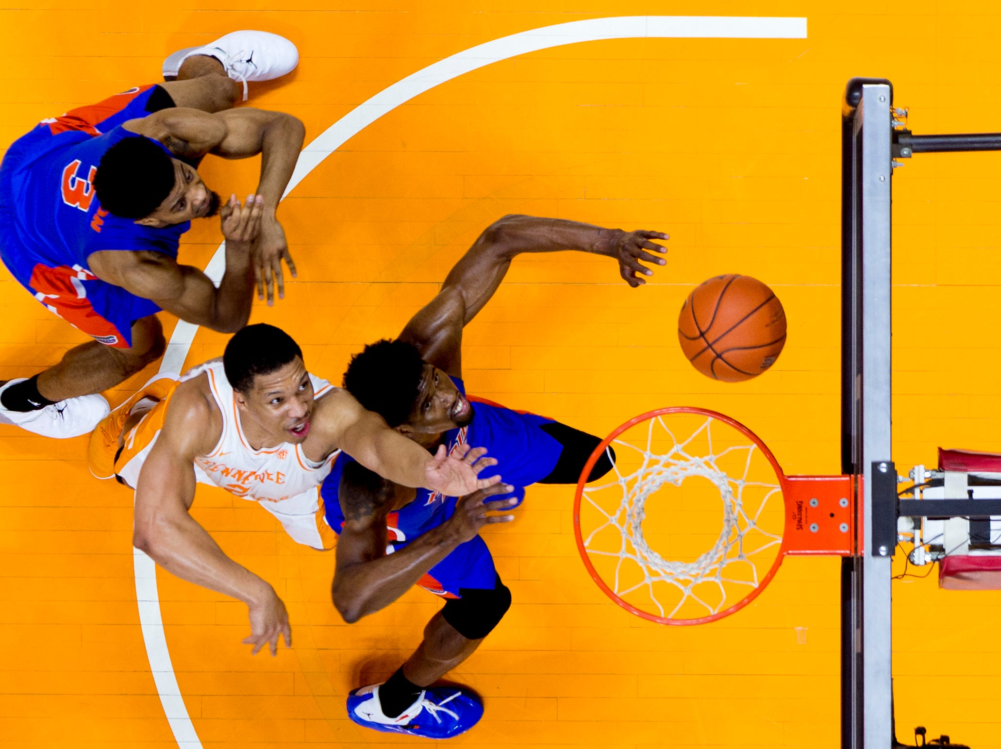 Tennessee forward Grant Williams (2) reaches for the ball past Florida center Kevarrius Hayes (13) during a game between Tennessee and Florida at Thompson-Boling Arena in Knoxville, Tennessee on Saturday, February 9, 2019.