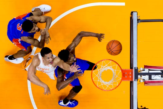 Tennessee forward Grant Williams (2) reaches for the ball past Florida center Kevarrius Hayes (13) during a game between Tennessee and Florida at Thompson-Boling Arena in Knoxville on Saturday, February 9, 2019.