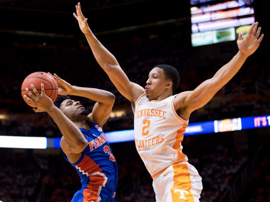 Tennessee forward Grant Williams (2) defends Florida guard Jalen Hudson (3) during Tennessee's home SEC conference game against Florida at Thompson-Boling Arena in Knoxville on Saturday, February 9, 2019.