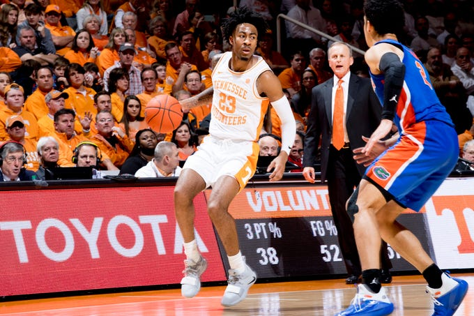 Tennessee guard Jordan Bowden (23) dribbles the ball down the court during a game between Tennessee and Florida at Thompson-Boling Arena in Knoxville, Tennessee on Saturday, February 9, 2019.