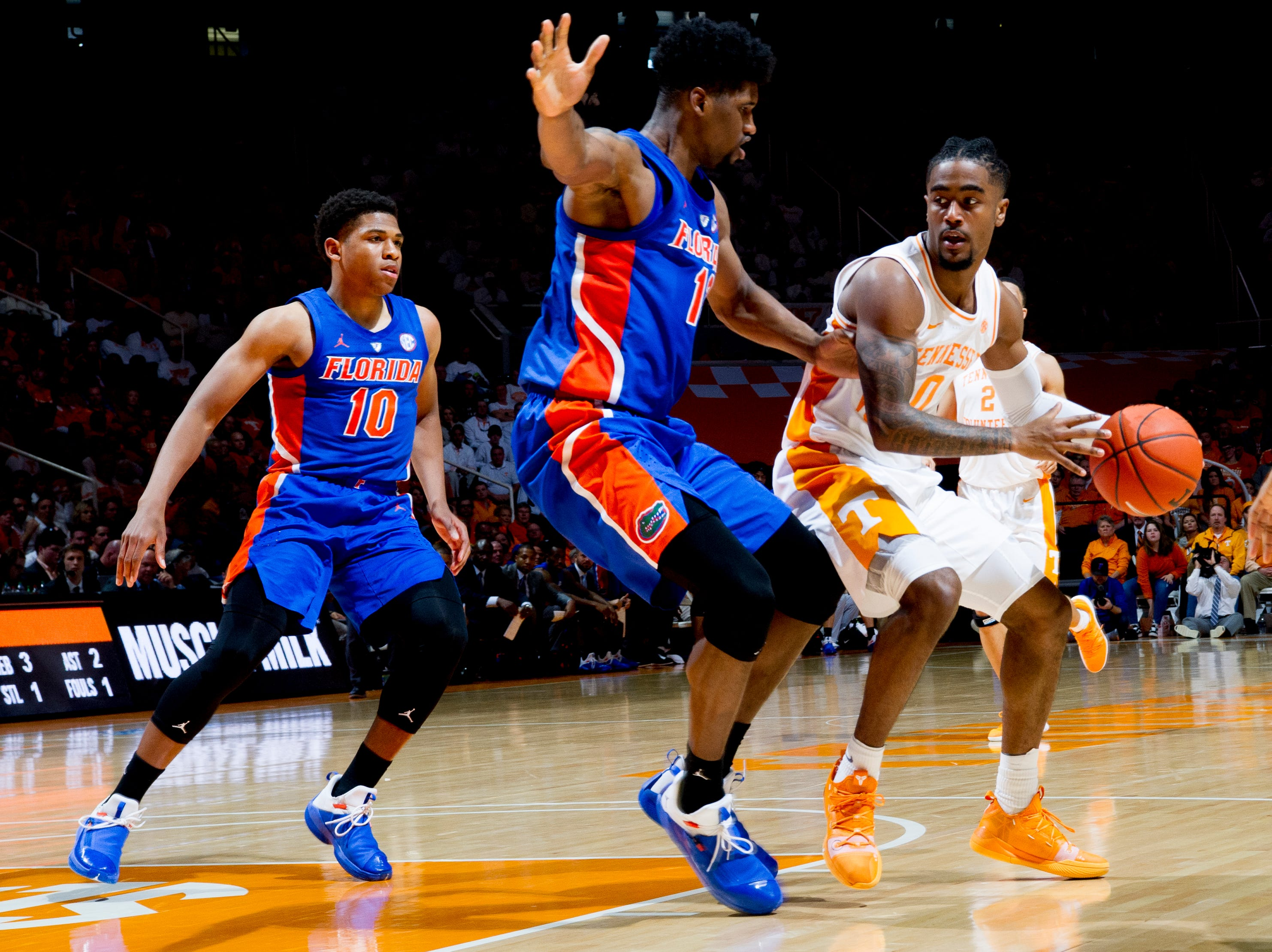 Tennessee guard Jordan Bone (0) is defended against by Florida center Kevarrius Hayes (13) during a game between Tennessee and Florida at Thompson-Boling Arena in Knoxville, Tennessee on Saturday, February 9, 2019.