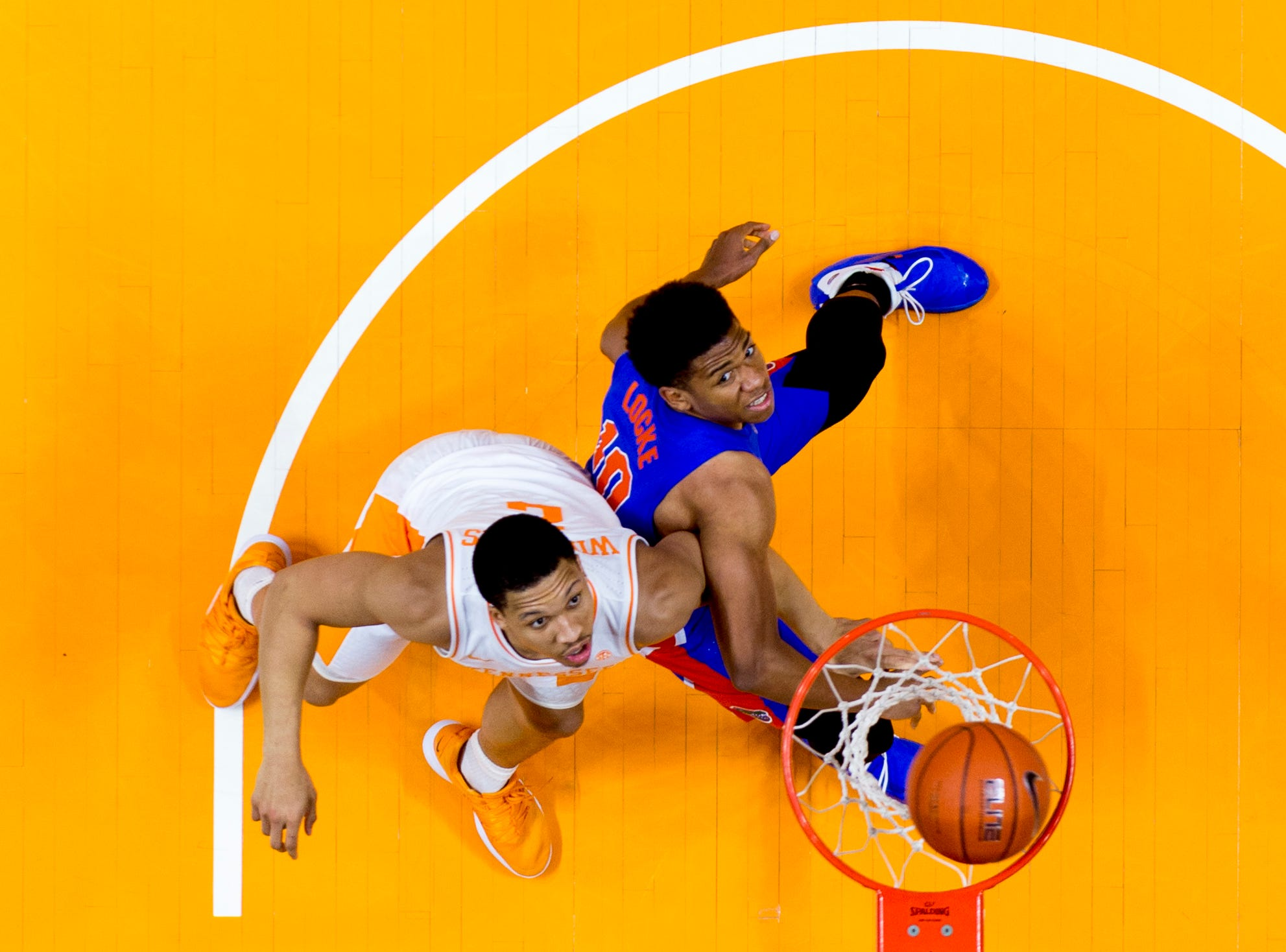 Tennessee forward Grant Williams (2) and Florida guard Noah Locke (10) eye the ball during a game between Tennessee and Florida at Thompson-Boling Arena in Knoxville, Tennessee on Saturday, February 9, 2019.
