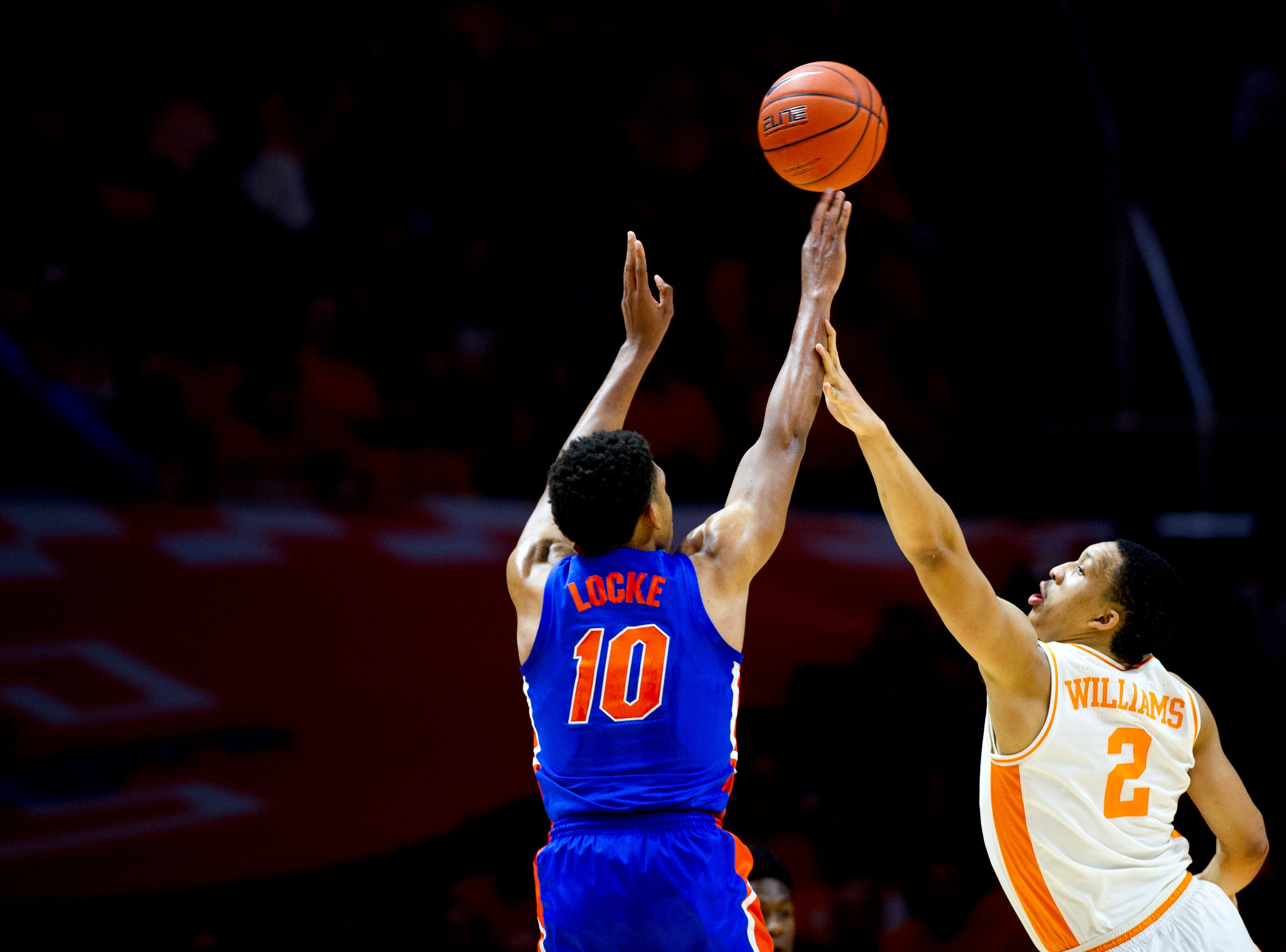 Florida guard Noah Locke (10) shoots the ball as Tennessee forward Grant Williams (2) defends during a game between Tennessee and Florida at Thompson-Boling Arena in Knoxville, Tennessee on Saturday, February 9, 2019.