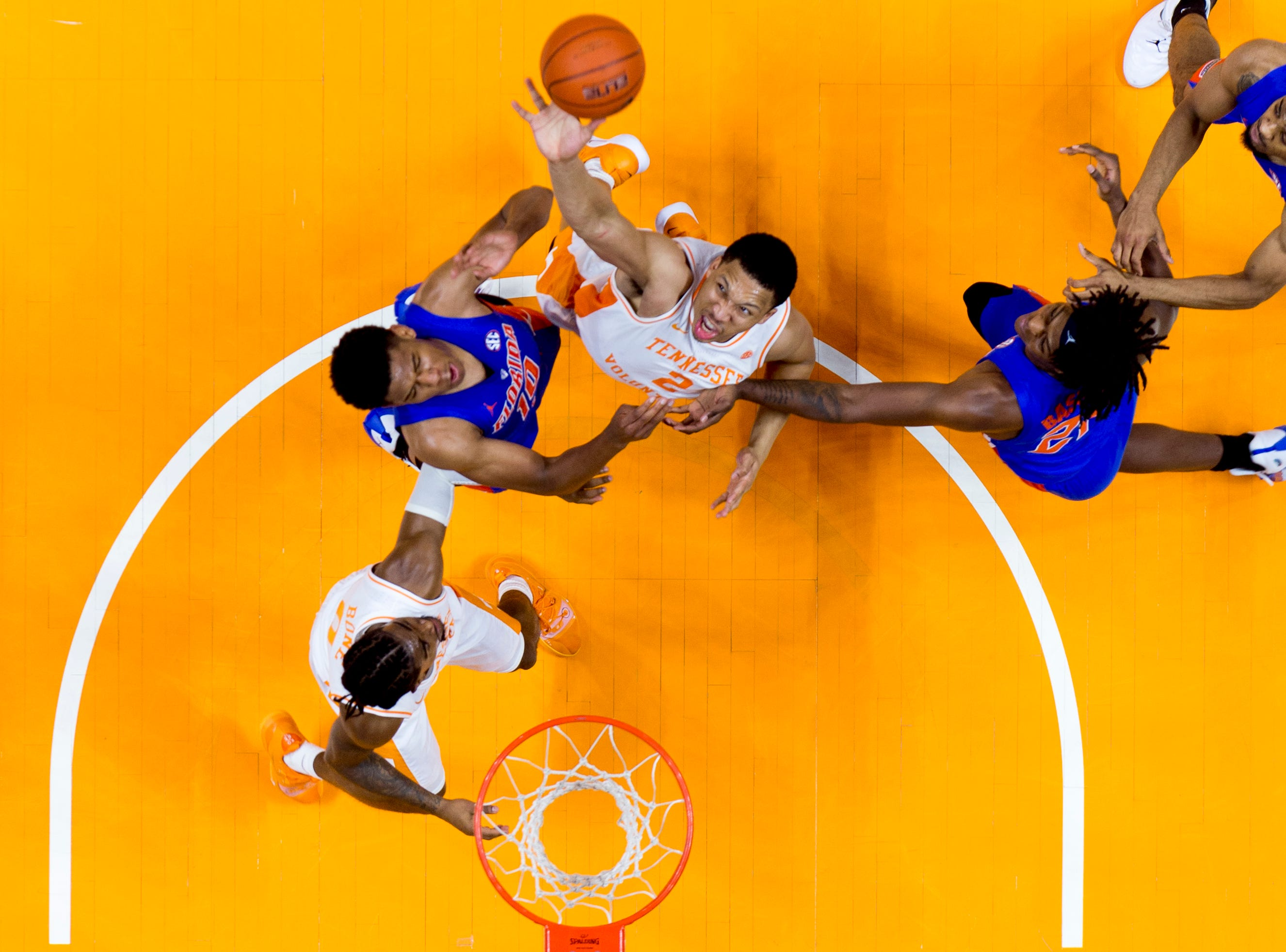 Tennessee forward Grant Williams (2) tries to grab the rebound past Florida guard Noah Locke (10) and Florida forward Dontay Bassett (21) during a game between Tennessee and Florida at Thompson-Boling Arena in Knoxville, Tennessee on Saturday, February 9, 2019.
