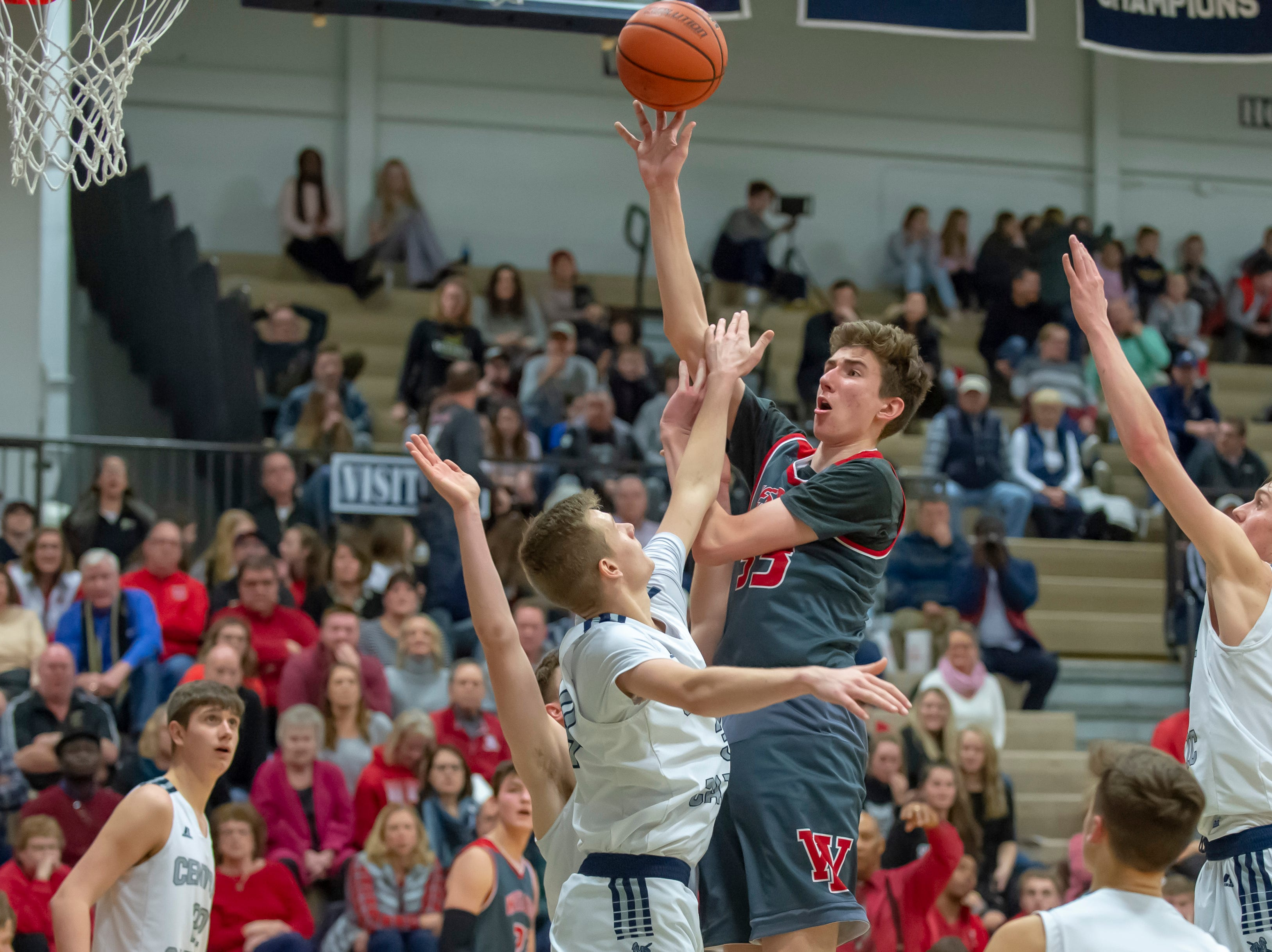 Rocco Muratori shoots from high above the West Lafayette at Central Catholic boys basketball rivalry game on 2/8/19