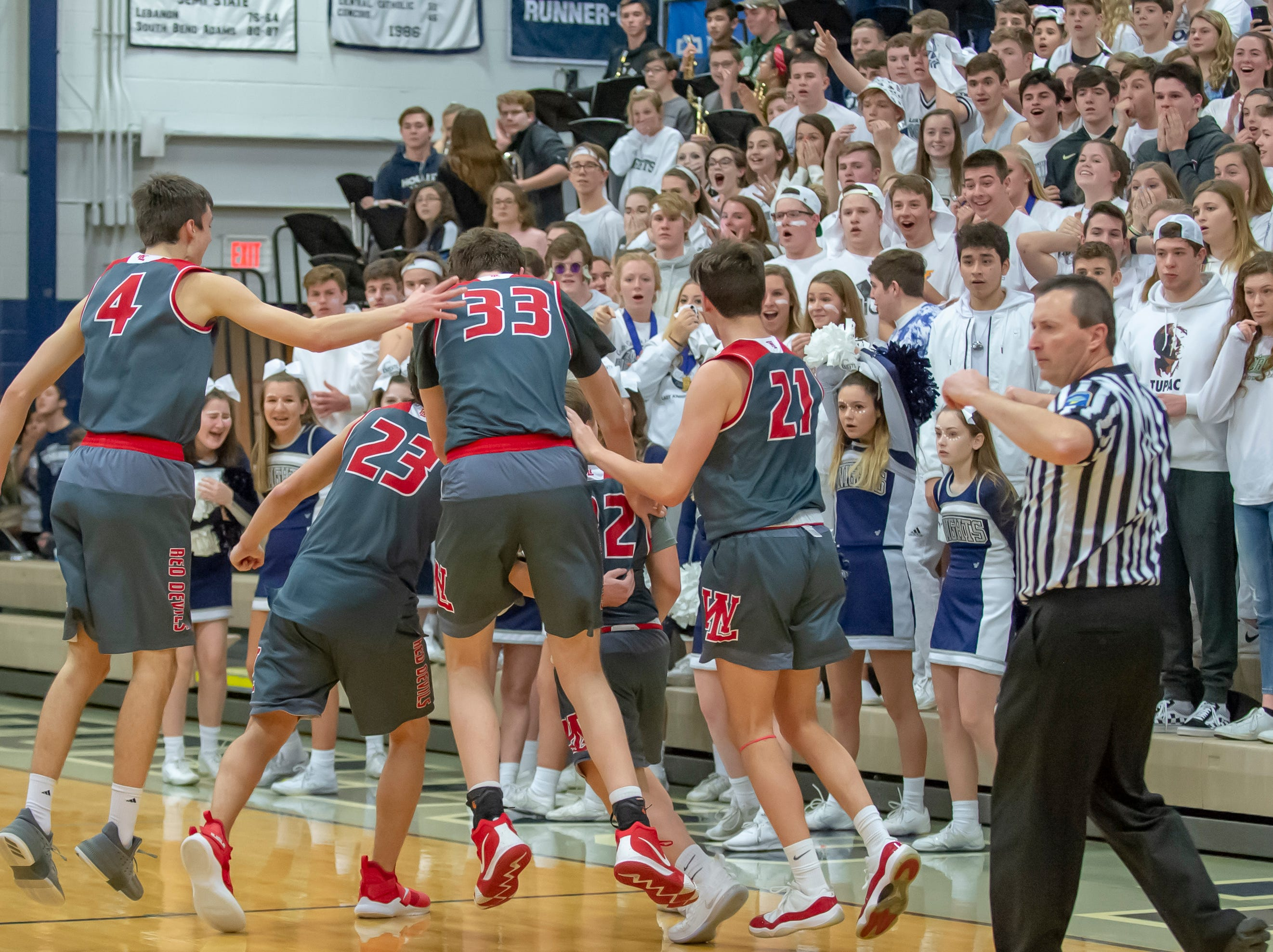 The aftermath of the Colin Martin game winning three at the buzzer in the West Lafayette at Central Catholic boys basketball rivalry game on 2/8/19