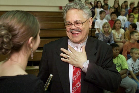In this photo from 2003, Bob Rohrman gets thanks for donating $3.5 million for a new performing arts center at Lafayette Jefferson High School, his alma mater.