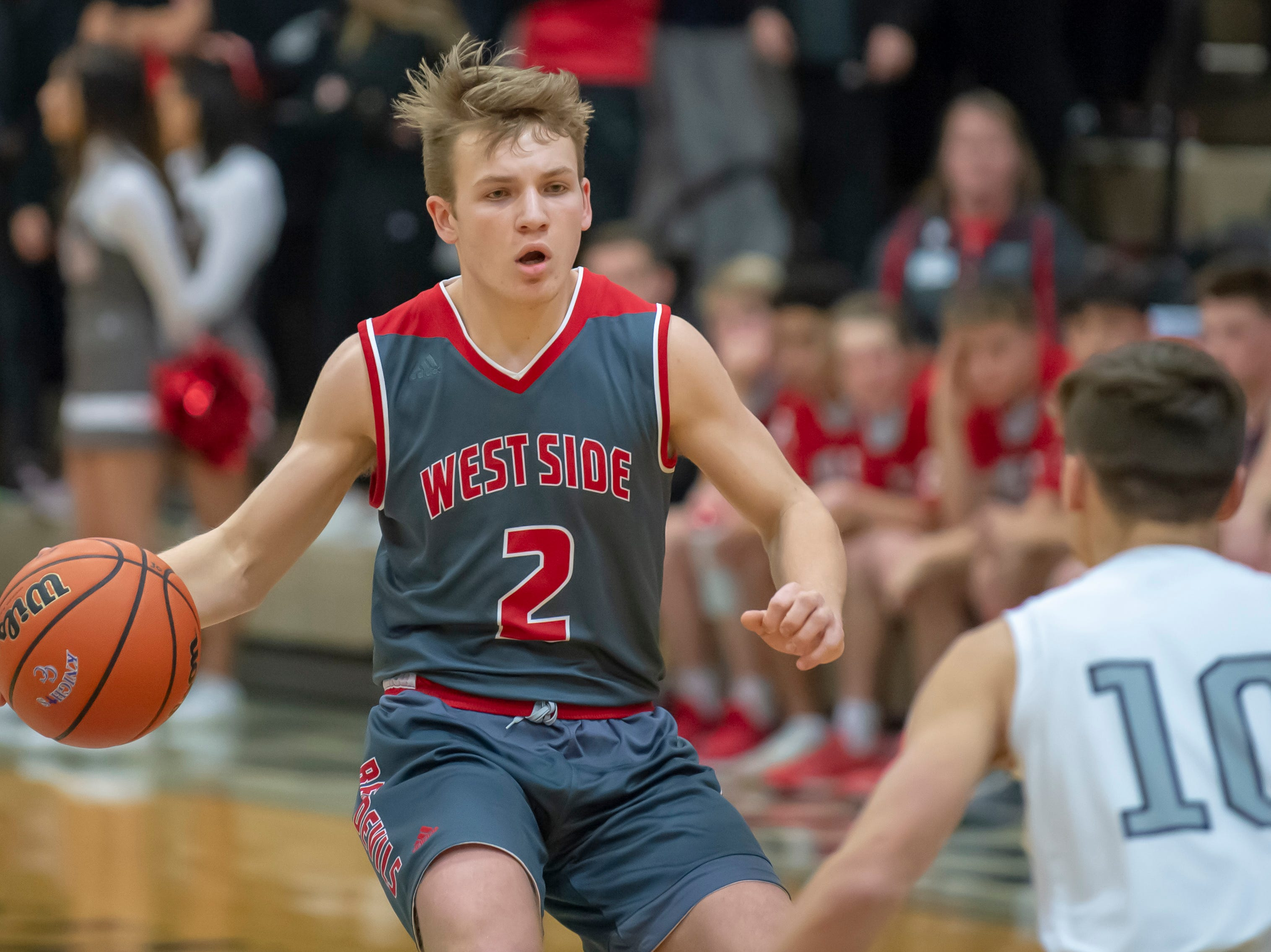 Tyler Boyle leads the way early in the West Lafayette at Central Catholic boys basketball rivalry game on 2/8/19