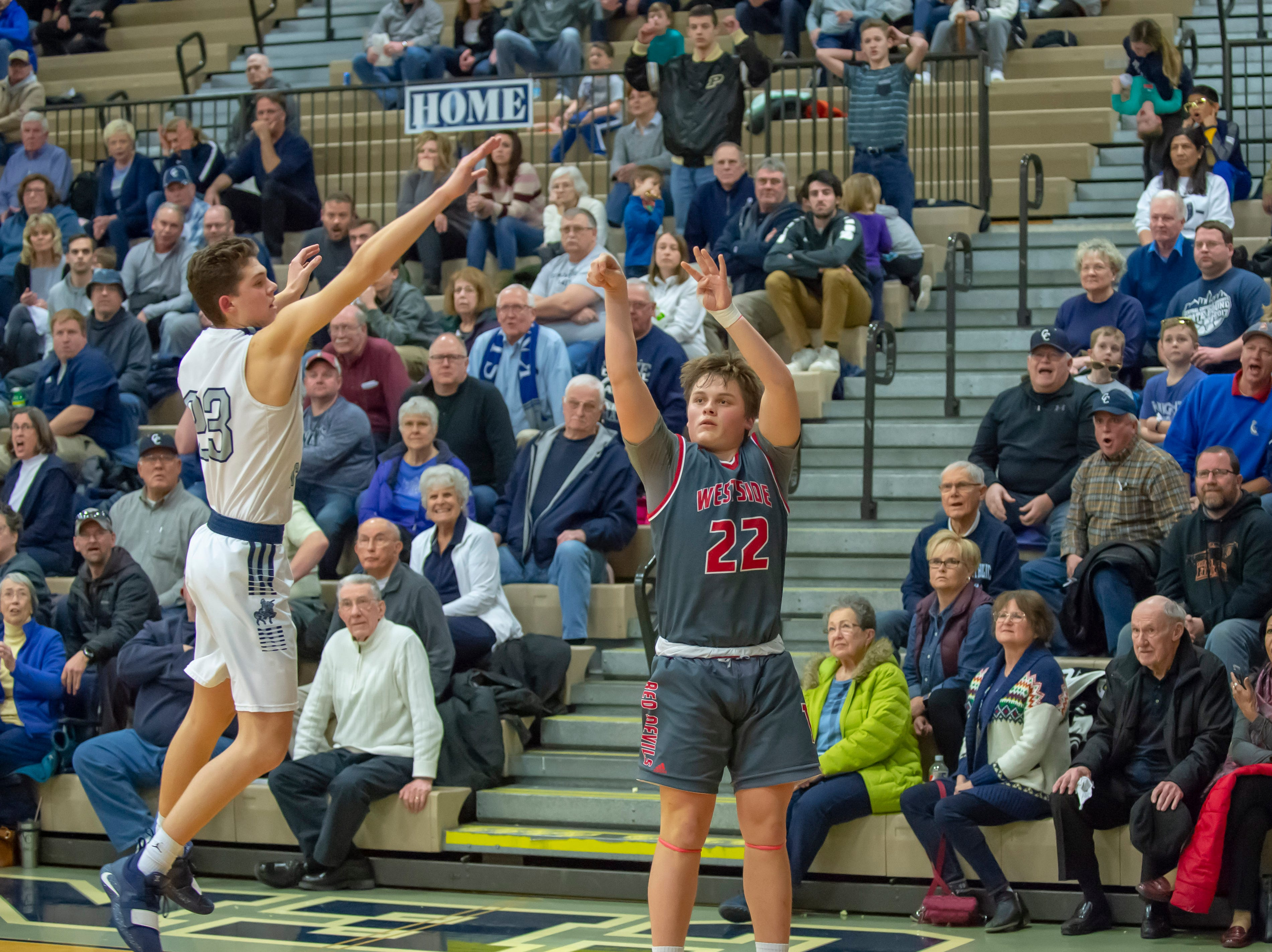 Colin Martin hits the game winning three at the buzzer in the West Lafayette at Central Catholic boys basketball rivalry game on 2/8/19