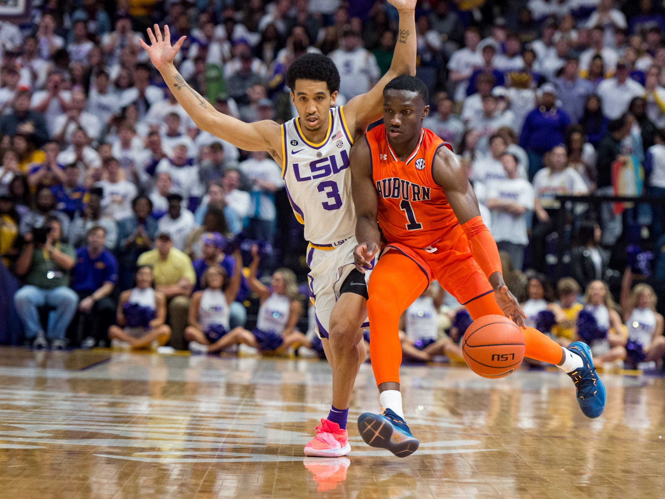 Jared Harper drives the ball downcourt and defended by Tremont Waters as the LSU Tigers take down the Auburn Tigers 83-78. Saturday, Feb. 9, 2019.