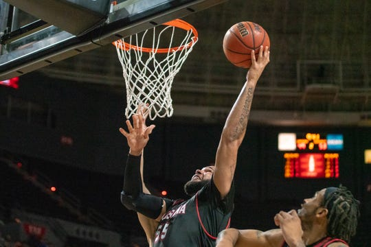 UL's Justin Miller jumps up to the goal to score as the Ragin' Cajuns take on the Georgia State Panthers at the Cajundome on Feb. 8, 2019.