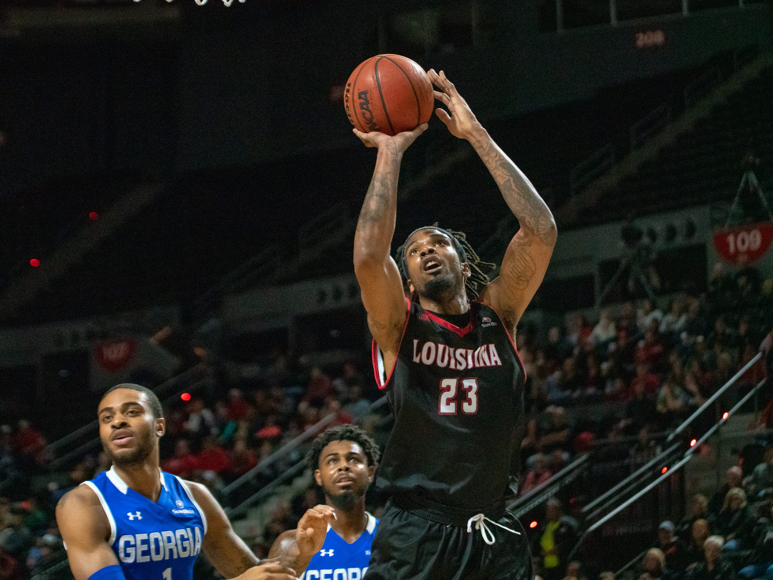 UL's Jakeenan Gant takes a shot from under the goal as the Ragin' Cajuns take on the Georgia State Panthers at the Cajundome on Feb. 8, 2019.